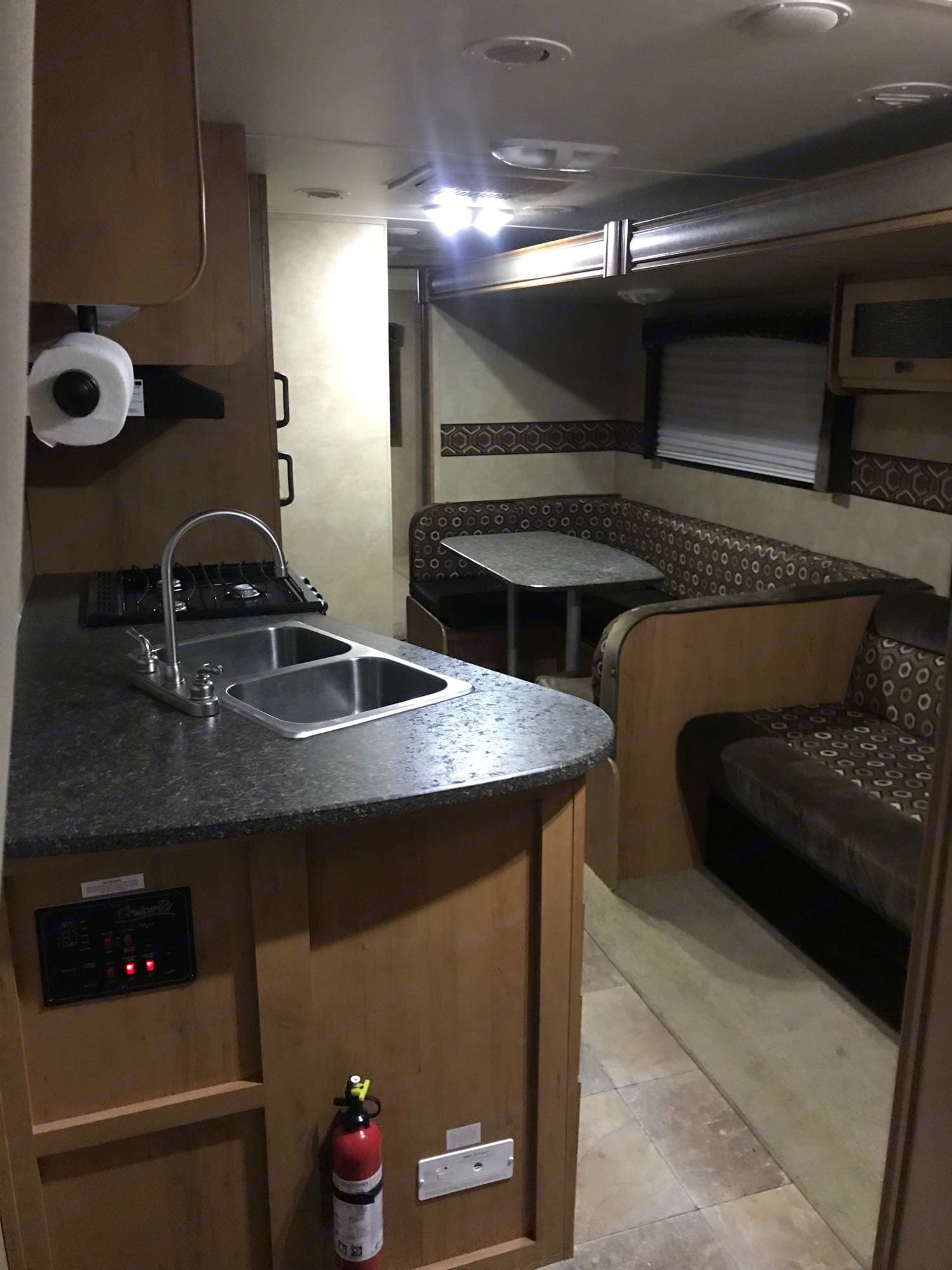 kitchen.  Couch and Table will convert to bed.. Cruiser Rv Corp Shadow Cruiser 2013