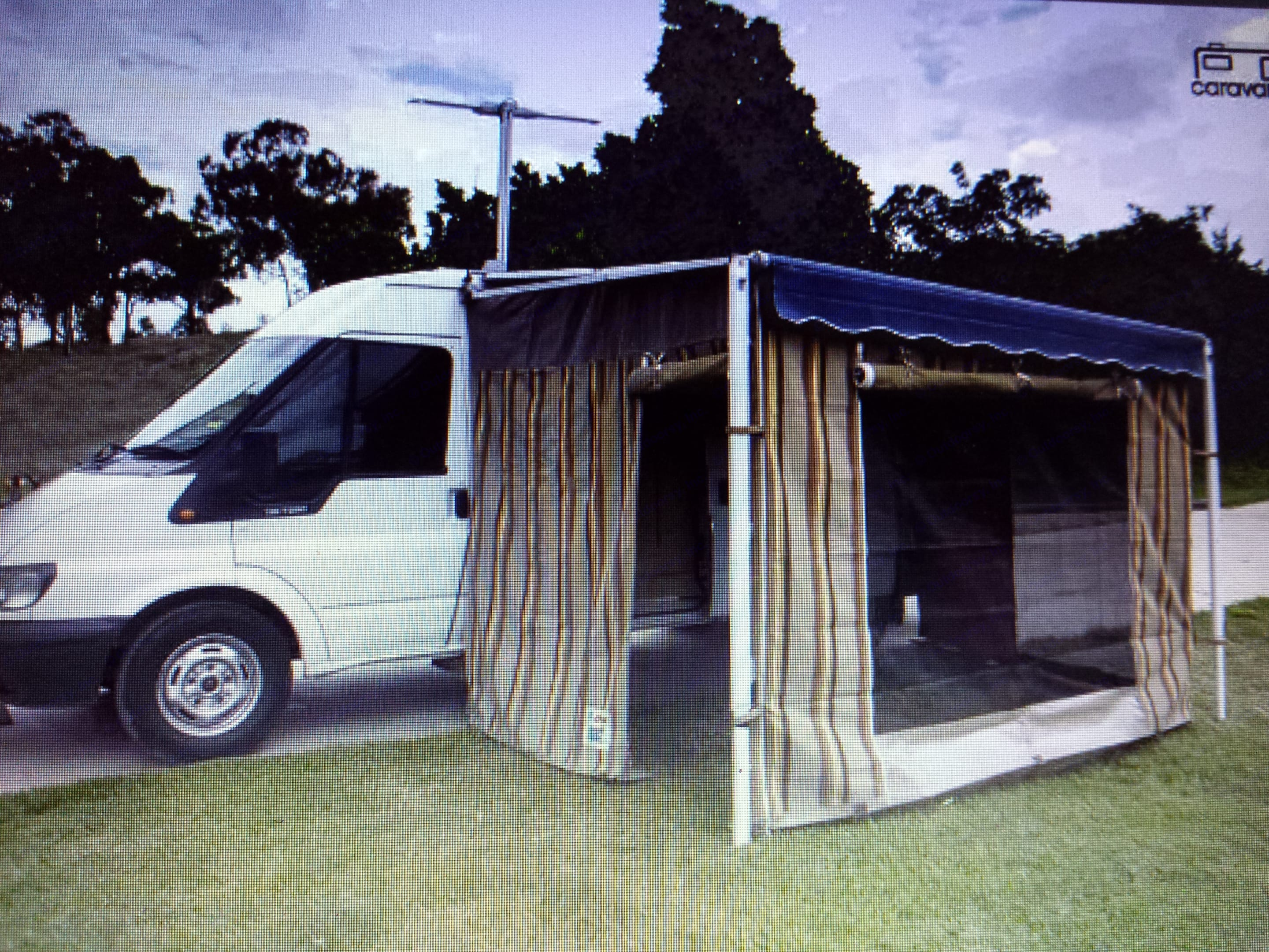 Full annex connected to awning with antenna receiving free to air TV. Annex can be assembled by one person in approx 20min. Ford Transit Custom 2006