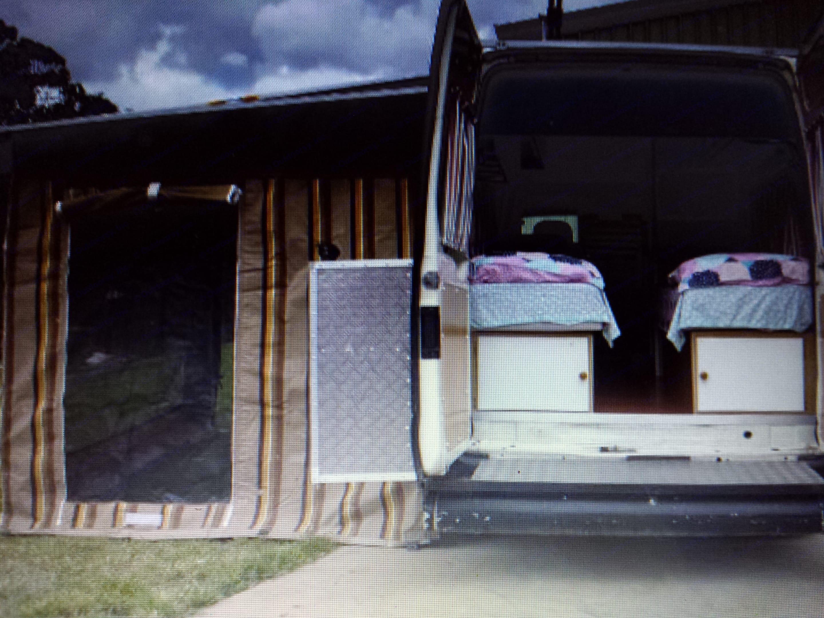 Rear view fully set up annex with walk through passage between two very comfortable single beds with storage below. Storage boxes on each door external. Ford Transit Custom 2006