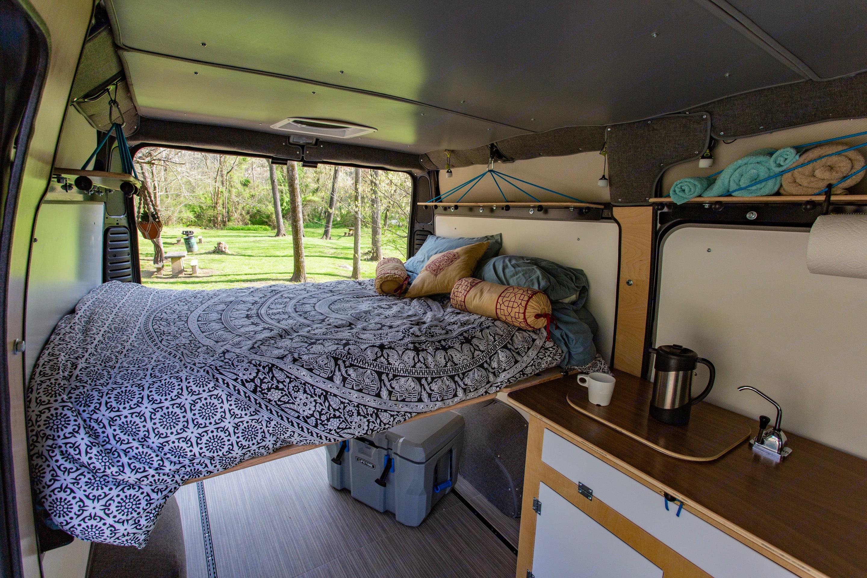 Comfy bed, sink & cook set.. Ram Promaster Camper 2019