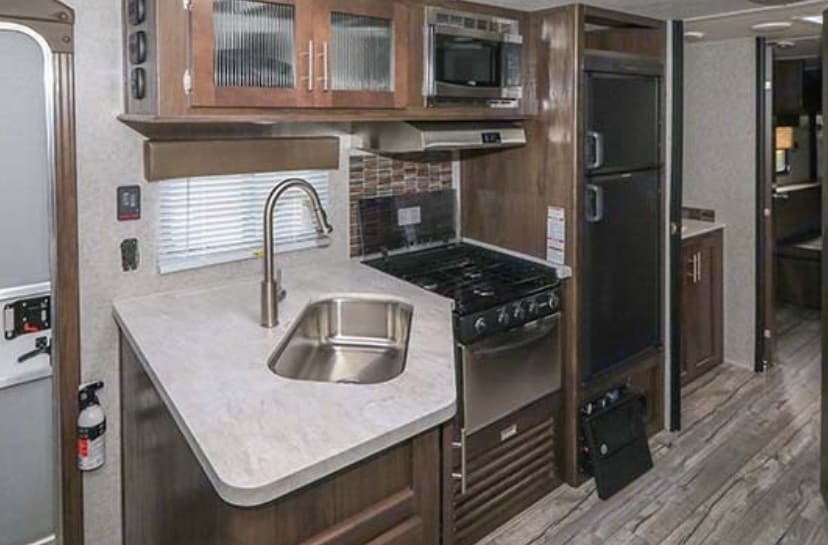 Comfortable kitchen with just enough counter space to prepare meals.. Forest River Cascade 2019