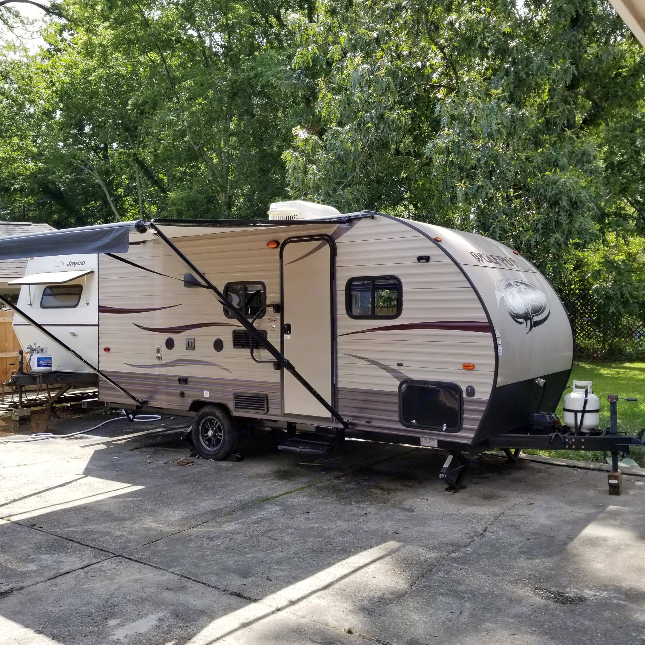 Full awning for rain and sun cover. . Forest River Cherokee Wolf Pup 16BHS 2016