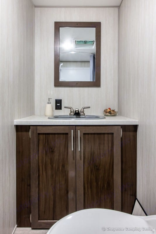 full bathroom with sink and storage, toilet with separate shower.. Forest River Wolf Pup 2020