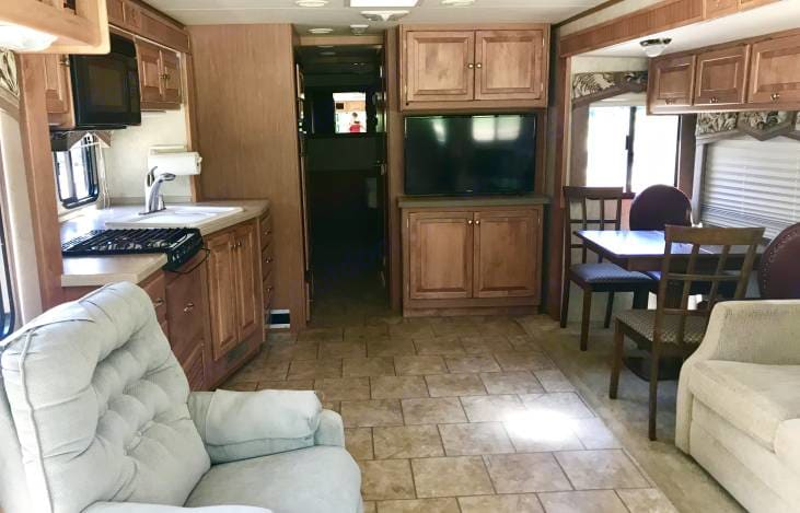 Inside the main space as you walk in with two living slide outs open. Tiffin Motorhomes Allegro Open Road 2008