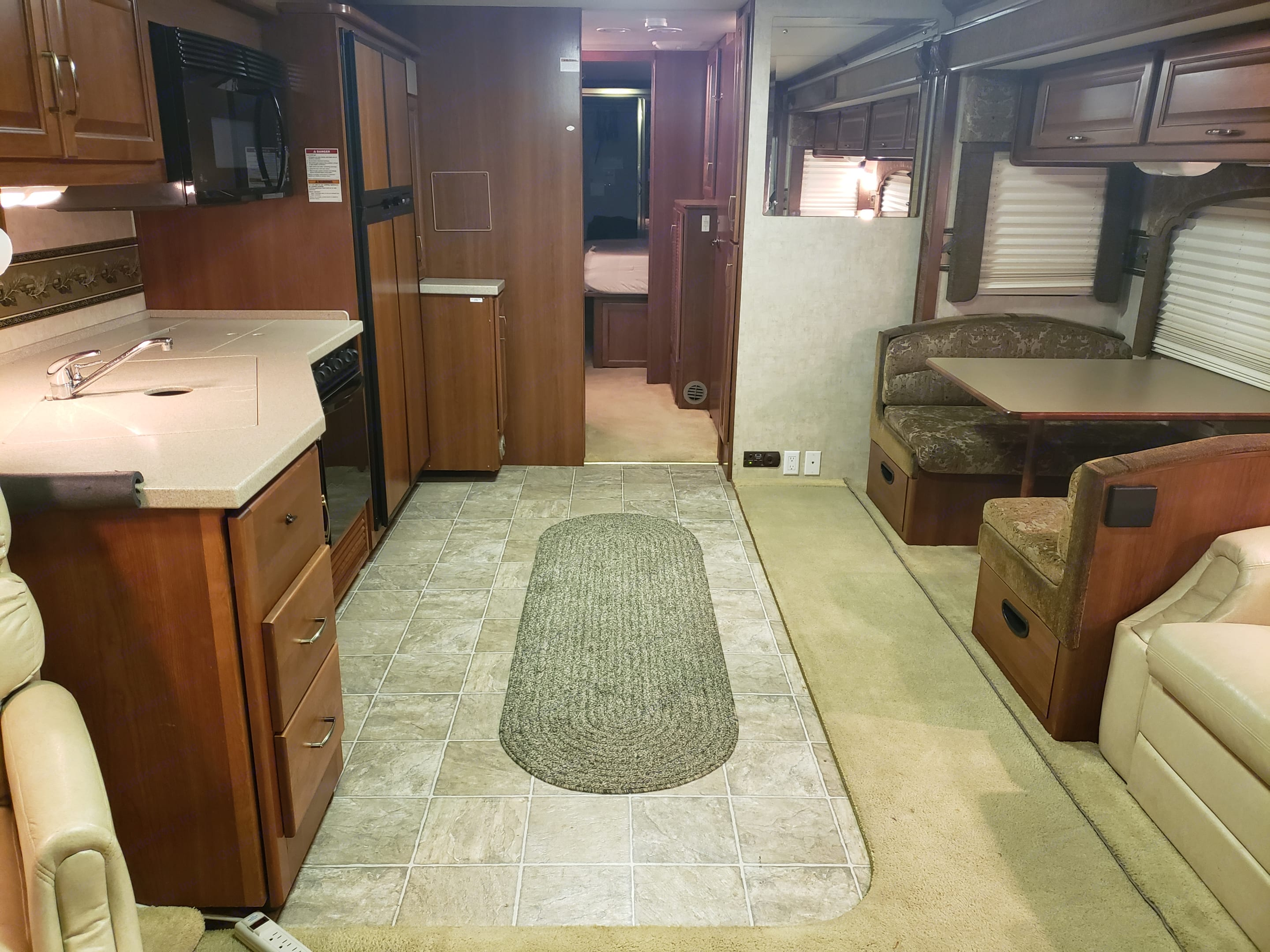 Wide open living space, the couch pulls out into a bed, the table turns into a bed, and on board we have a 2 tents and 3 blow up mattresses also! . Fleetwood Bounder 2005