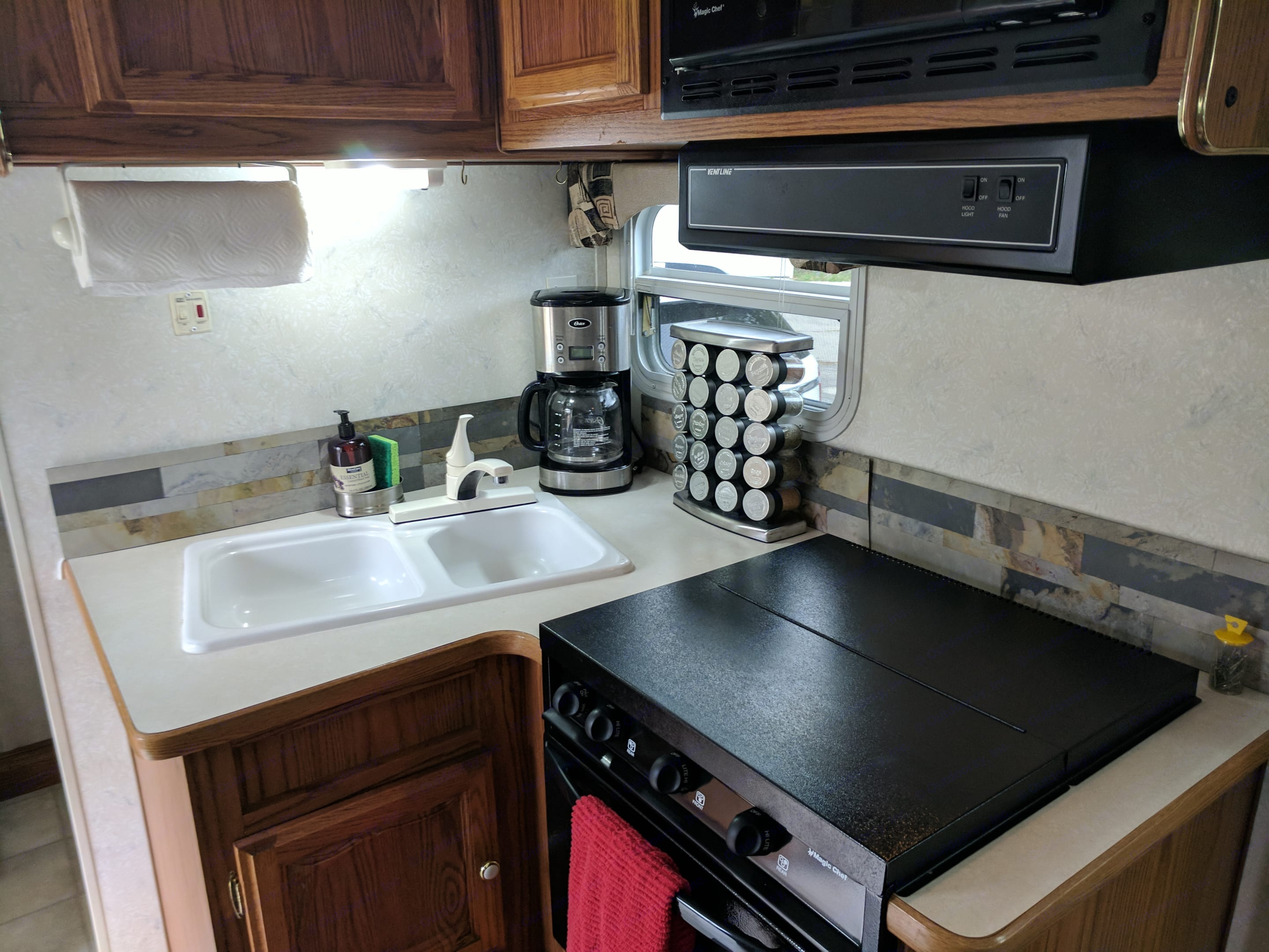 Cooking is a breeze in this fully furnished kitchen with stove, cooktop and microwave! . Forest River Sandpiper 2003