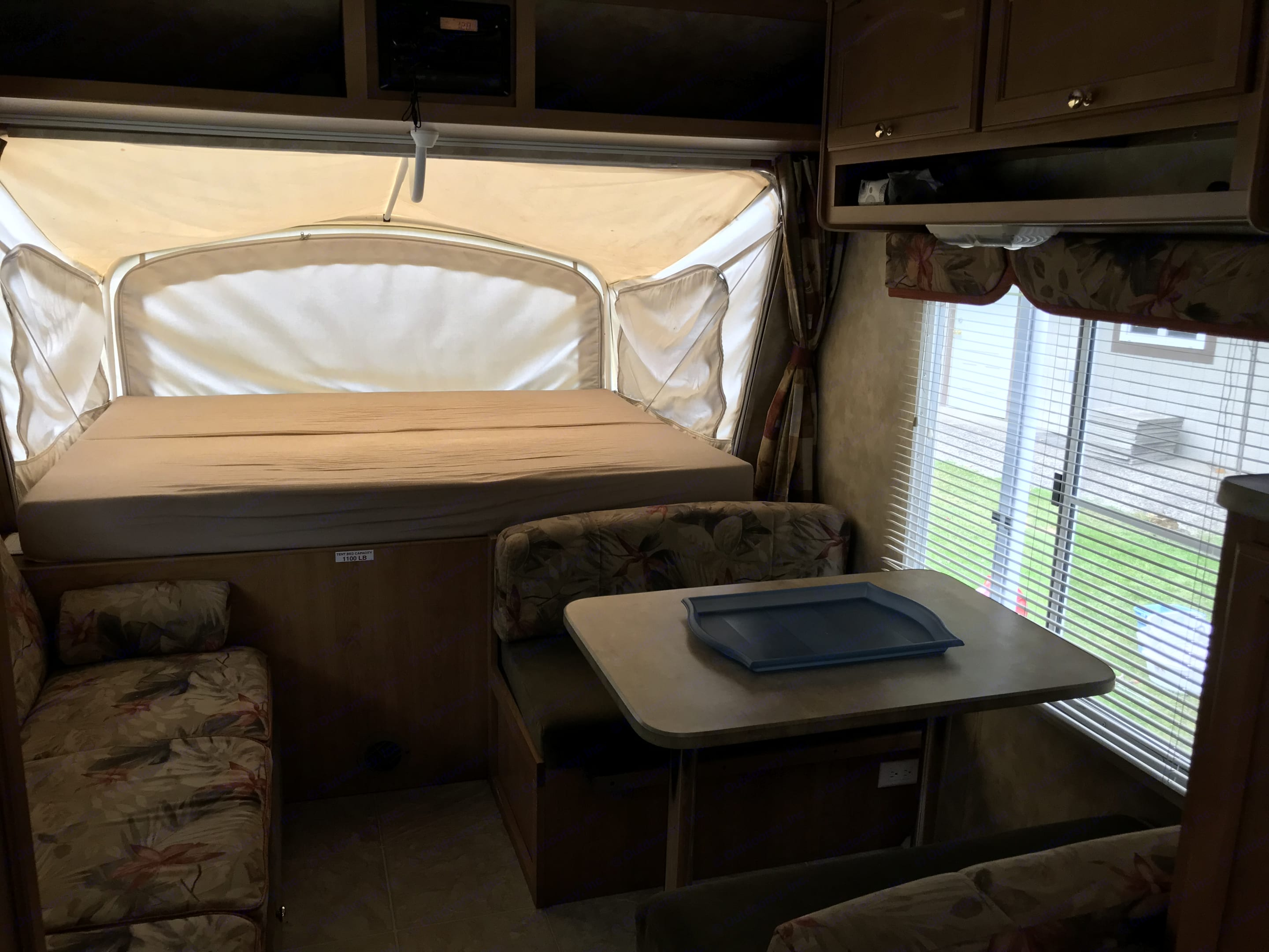 Eating area and large queen bed. Fleetwood Orbit 2006