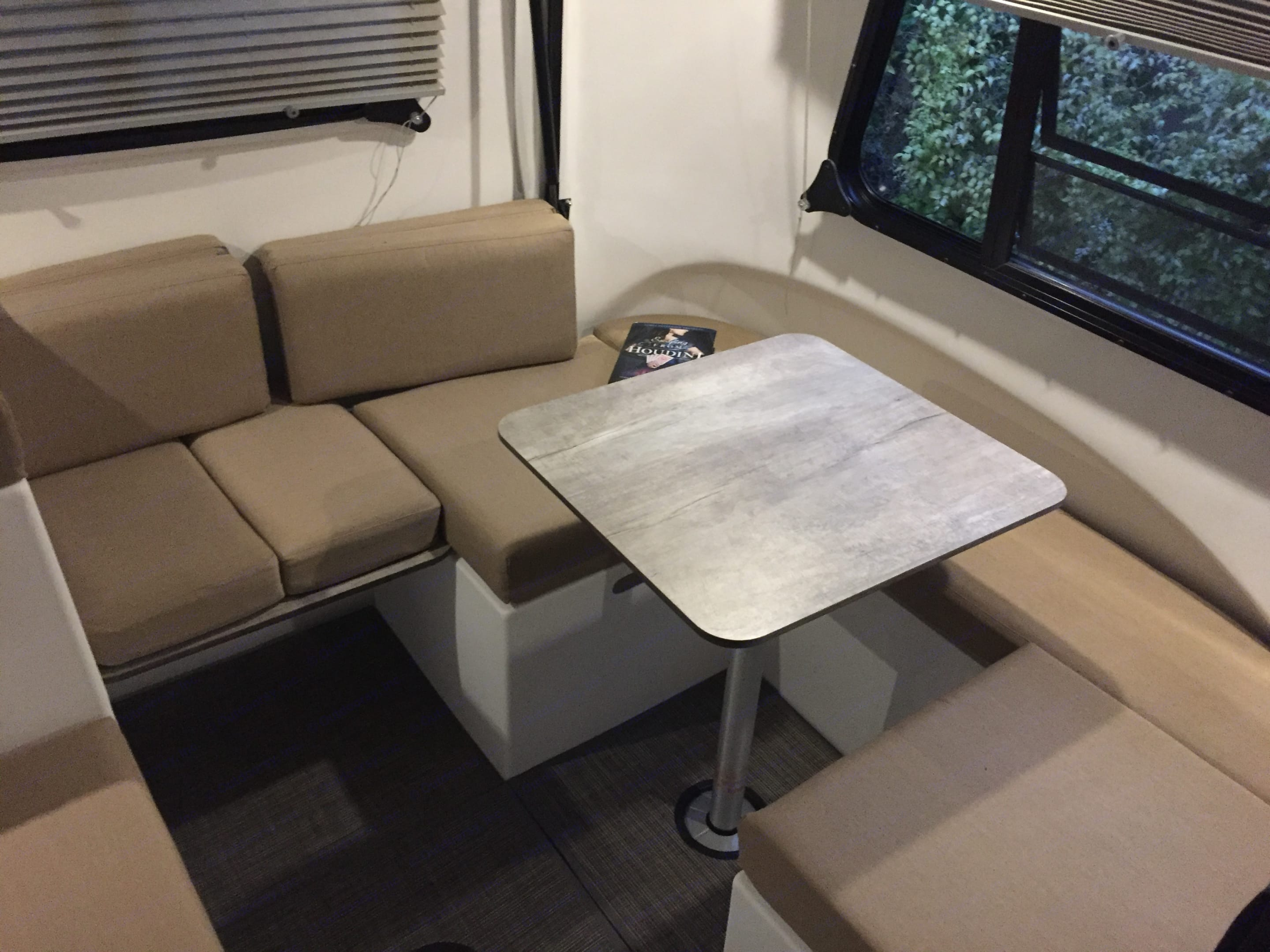 Modular seats and tables moved to a side table with lounge area (this is the queen sized sleeping area at the back). Want more table space? This is only one of four tables. Move them around and have fun creating your own space.. happier camper HC1 2019