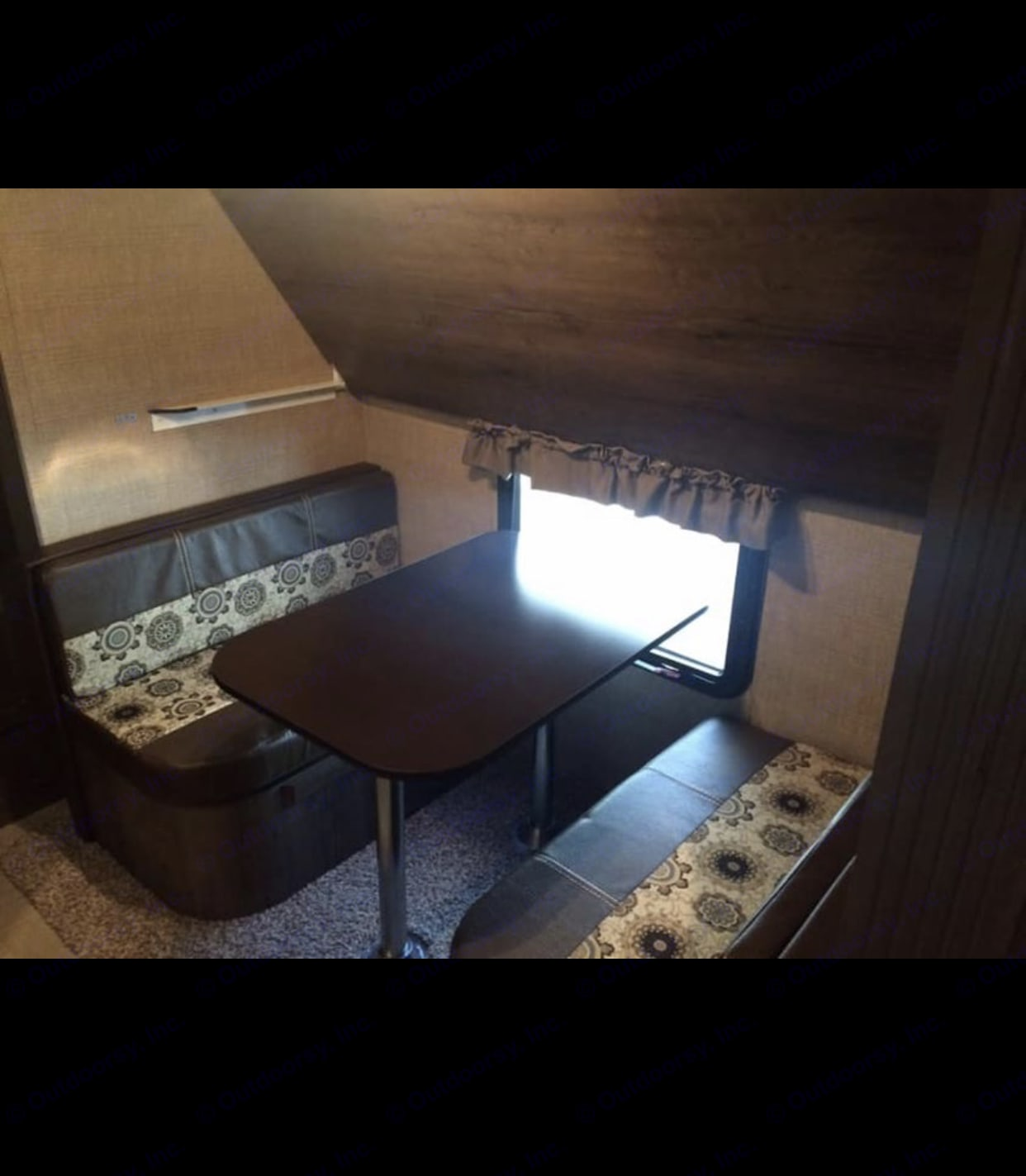 Rear bunk house with a dinette that also turns into a bed. Dutchmen Kodiak 2016