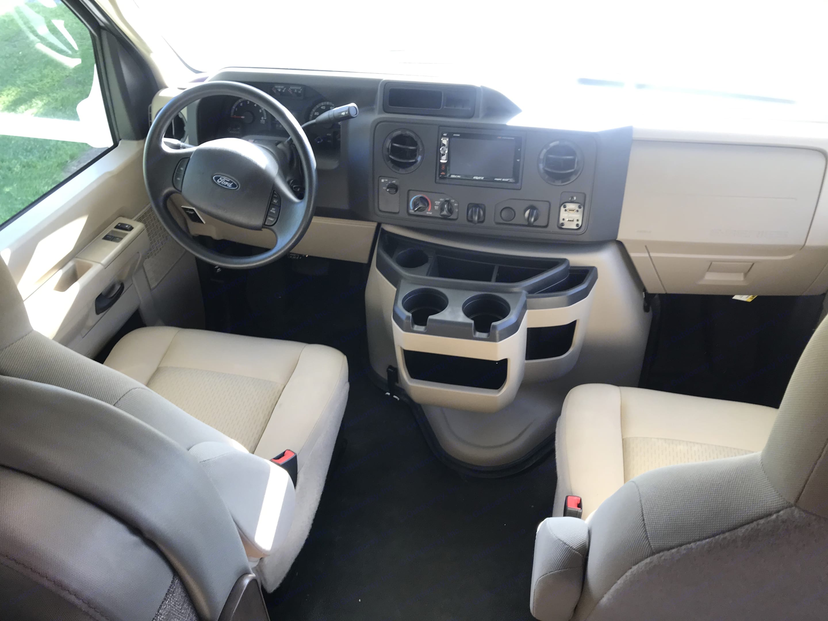 Comfortable cabin for both driver and passenger. Features back-up camera, cup holders, USB, Bluetooth radio, air-conditioning and ample storage for miscellaneous items.. Thor Motor Coach Four Winds 26B 2019