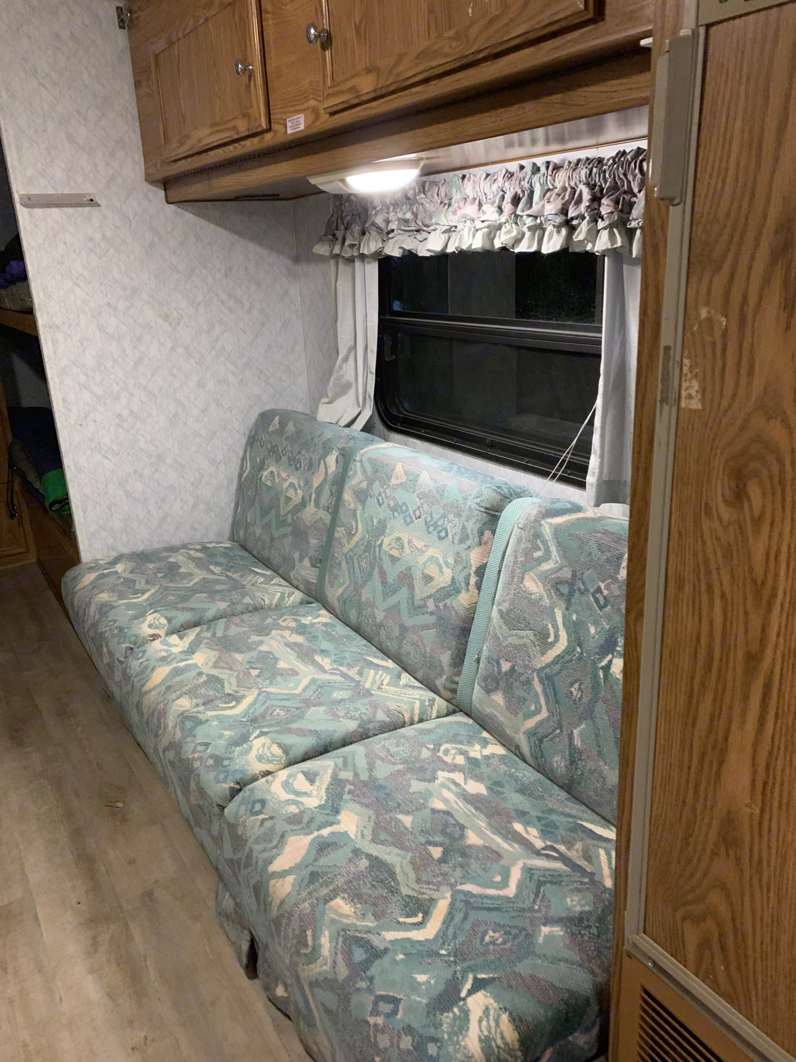 Sofa bed that is opposite the kitchen area.  Easily converts to a comfy bed for 1 or 2.  There are cupboards above the sofa for your grocery items.  As well, there is ample space under the sofa for storage bins.  . Terry 22' Travel Trailer 1996