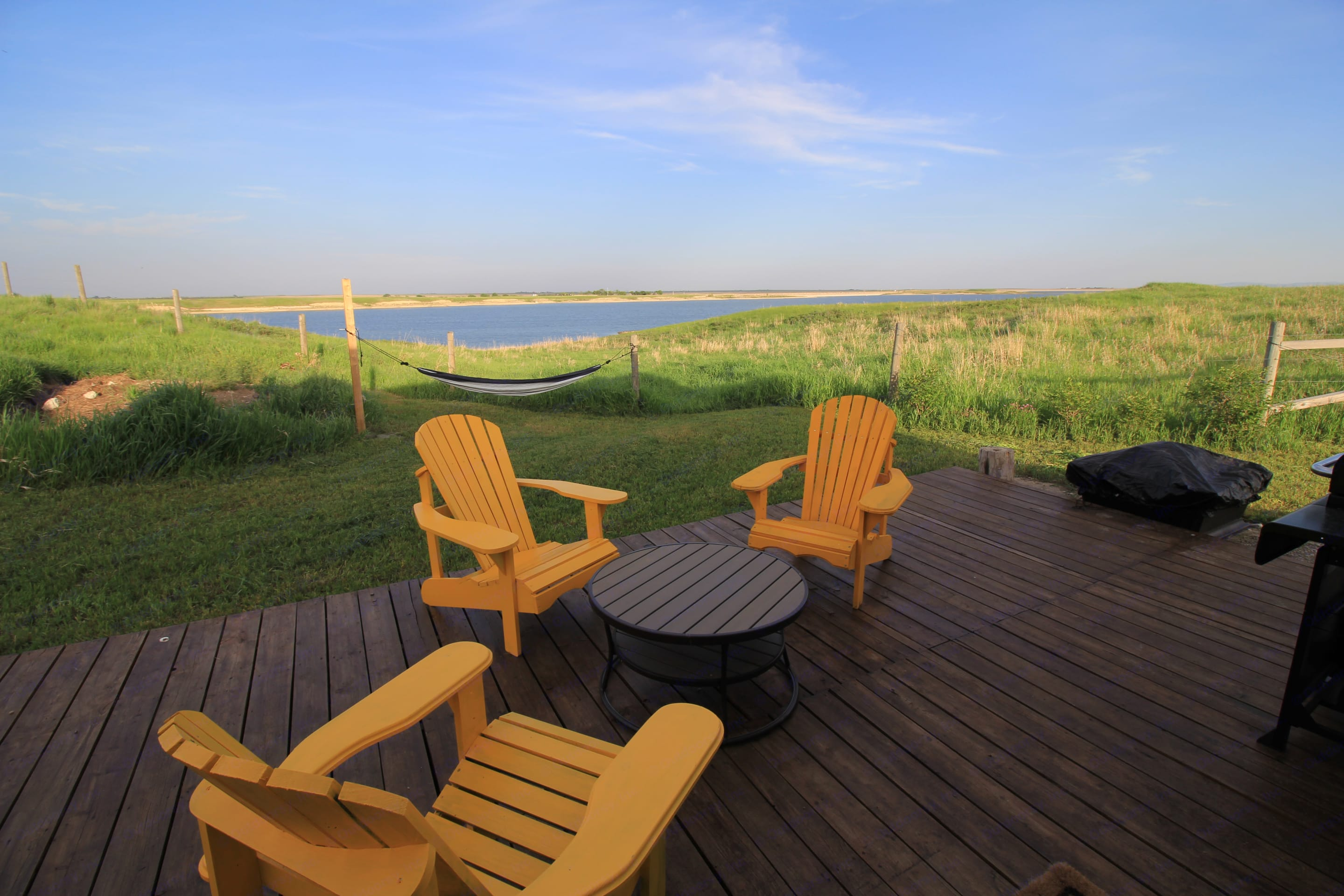 Enjoy your coffee in the mornings on the deck with a view or relax in the hammock.  4 Wooden Adirondack Chairs provided, and additional camp chairs. BBQ and fire pit. . Keystone Cougar 2001