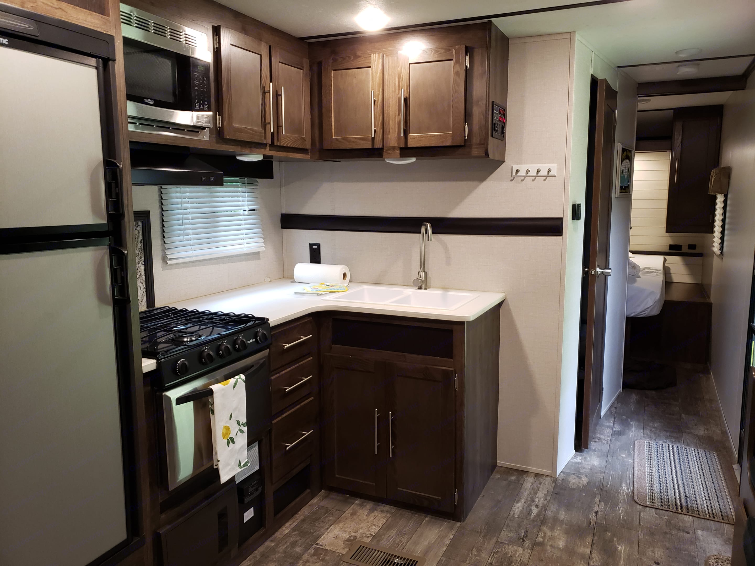 Four burner gas range with oven and microwave.. Crossroads Other 2018
