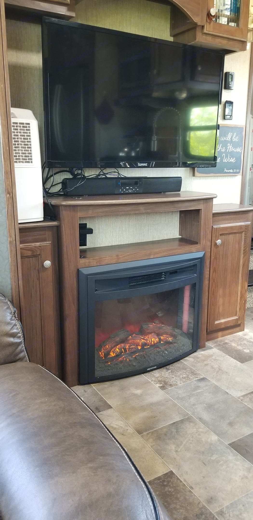 Not just for looks, this fireplace can heat the camper comfortably on cold nights, and makes a cozy gathering place!. Keystone Sprinter 2018