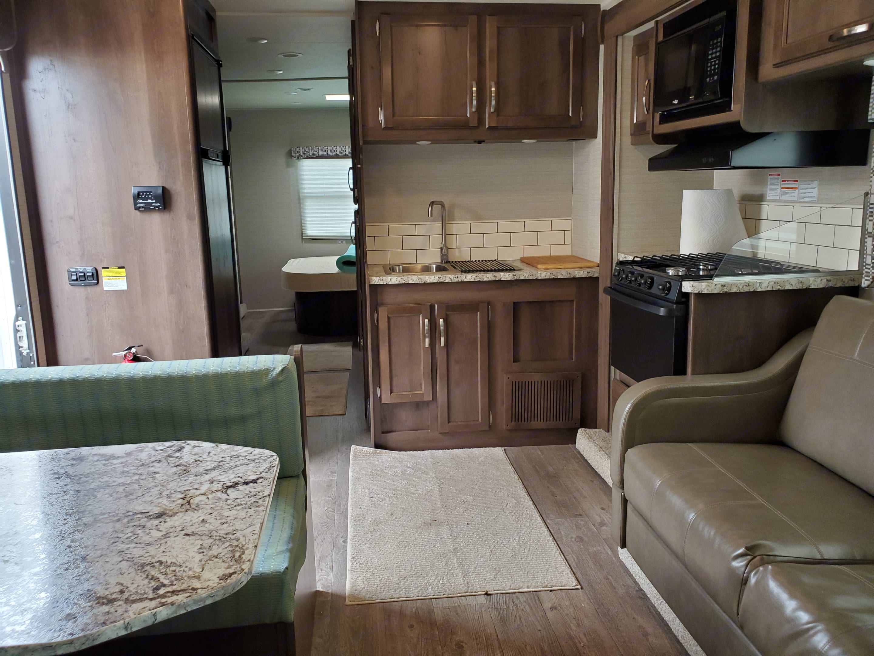 Fully equipped kitchen, including roomy dual mode fridge . Jayco Redhawk 2018