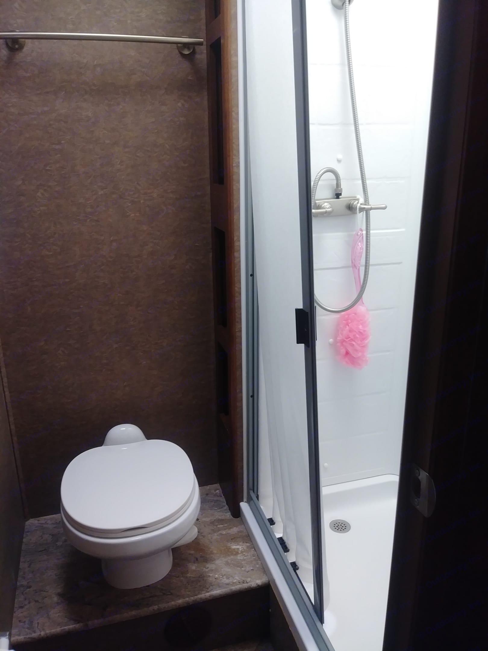 Toilet and nice size shower. Coachmen Pursuit 2014