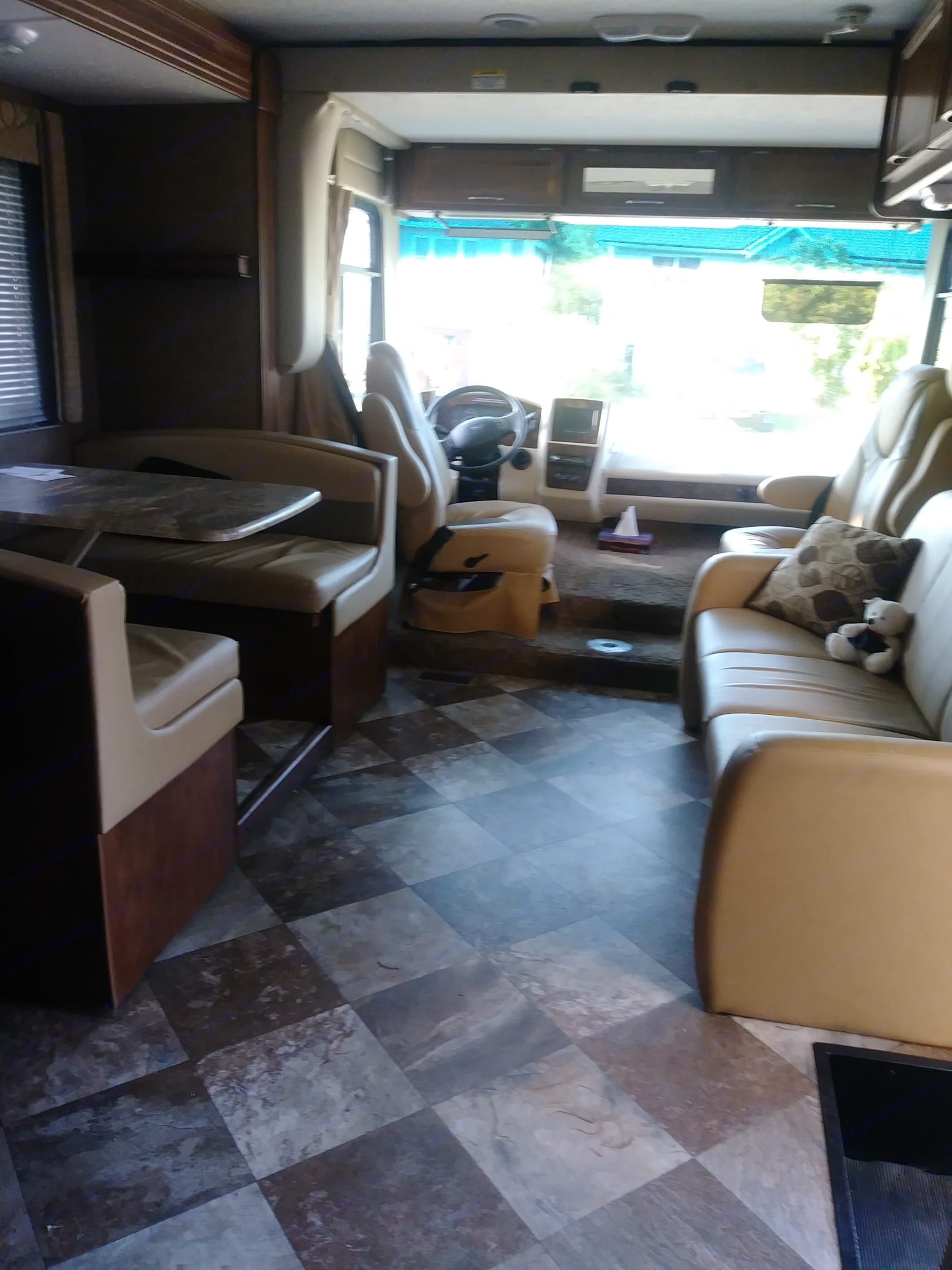 There is also a table that goes between the front seats if required. Back up and side camera display. Coachmen Pursuit 2014