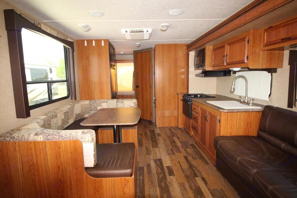 Standing near the front door looking toward the back of the camper.. Starcraft Travel Star 2015
