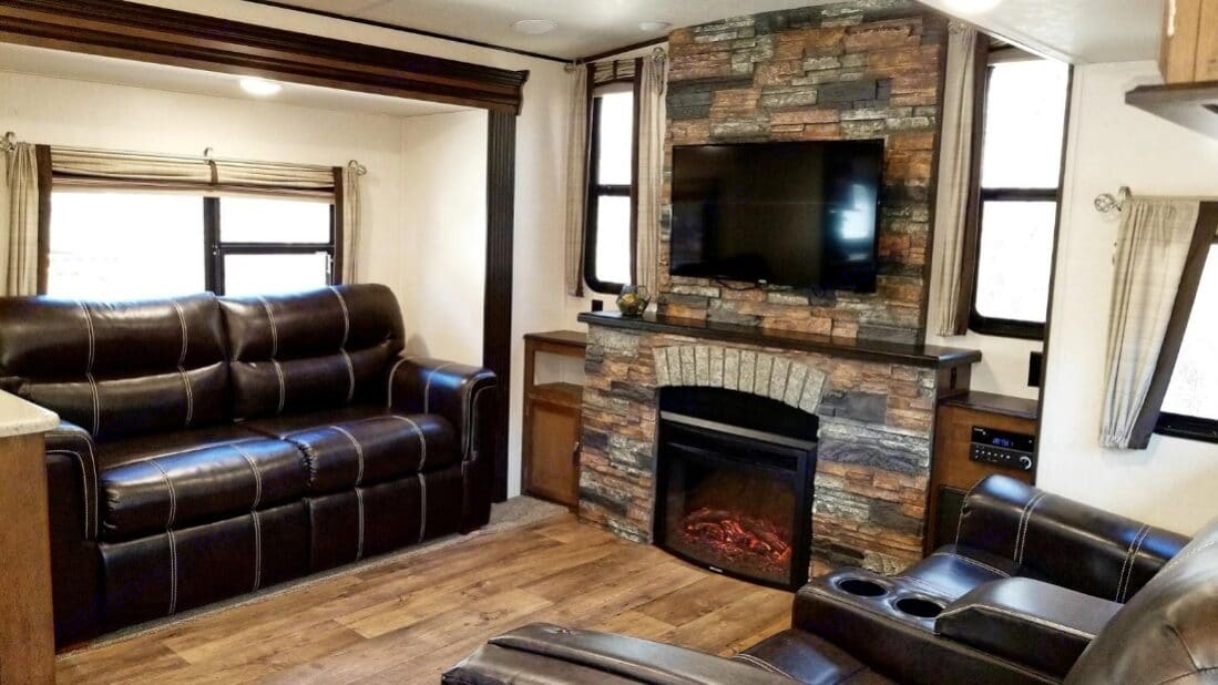 Queen sofa sleeper, and two reclining theater chairs. Beautiful Electric Fireplace with DVD player and TV. . Forest River Heritage Glen 2017