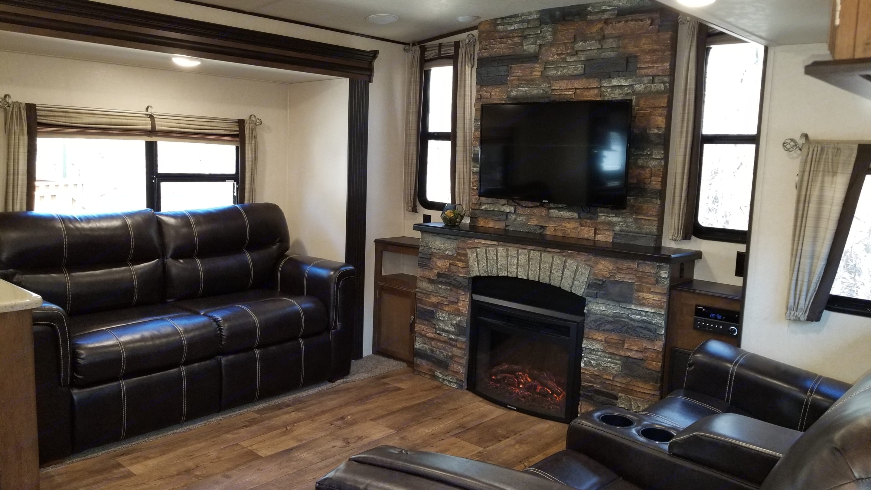 living area with electric fireplace. Forest River Heritage Glen 2017