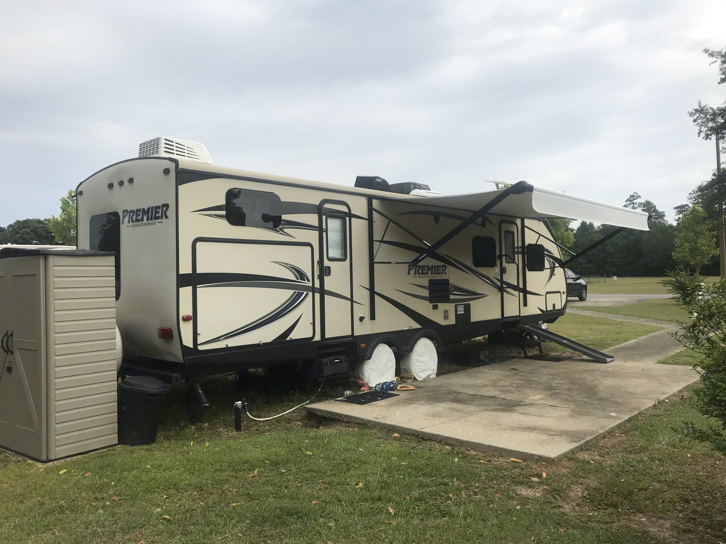 Side view: storage, double entrance (one to main entrance and one to bathroom) and outside  grilling area. Keystone Bullet Premier 2016