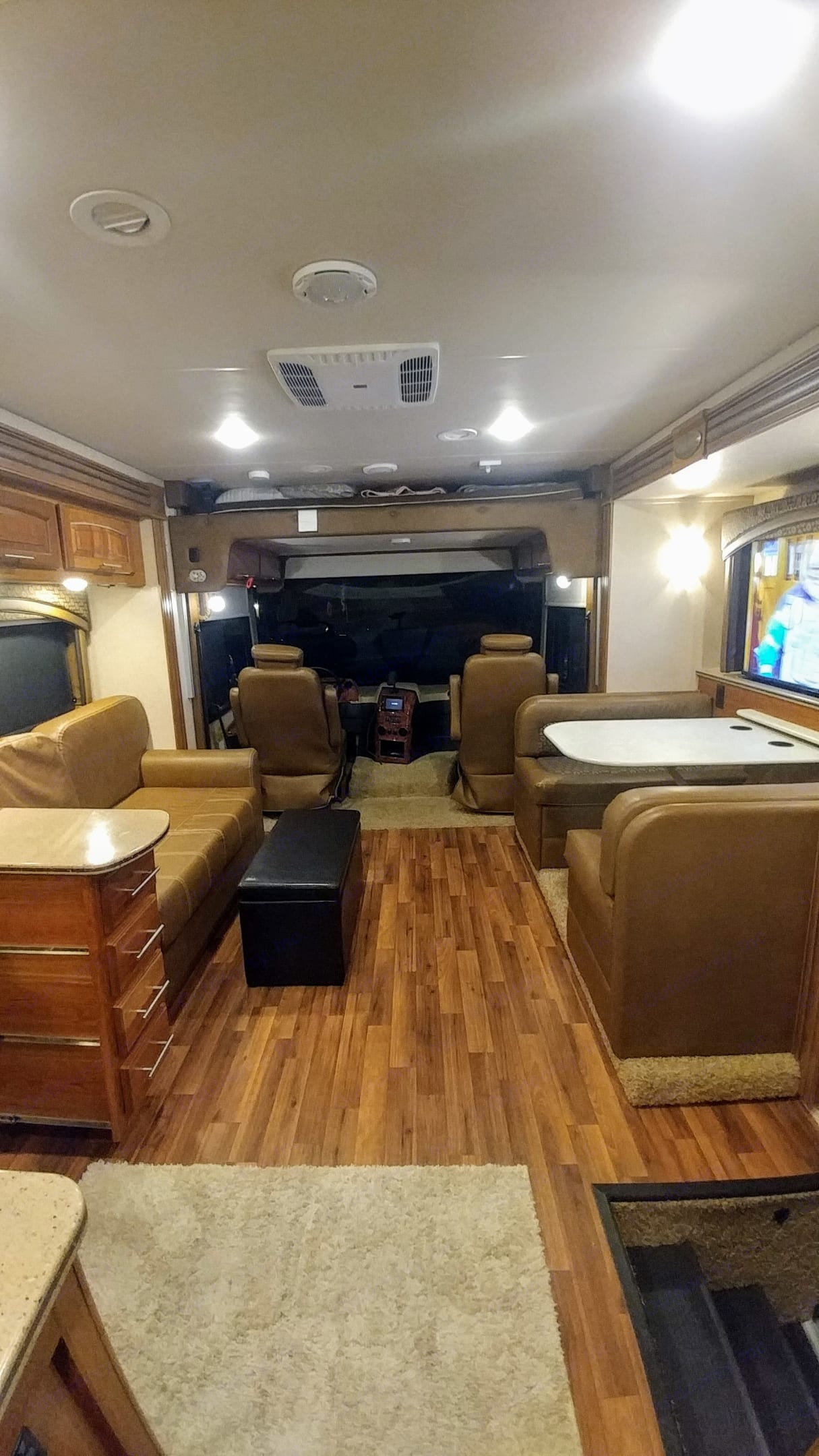 Swiveling Captains chairs give seating for 8. Jayco Precept 2016