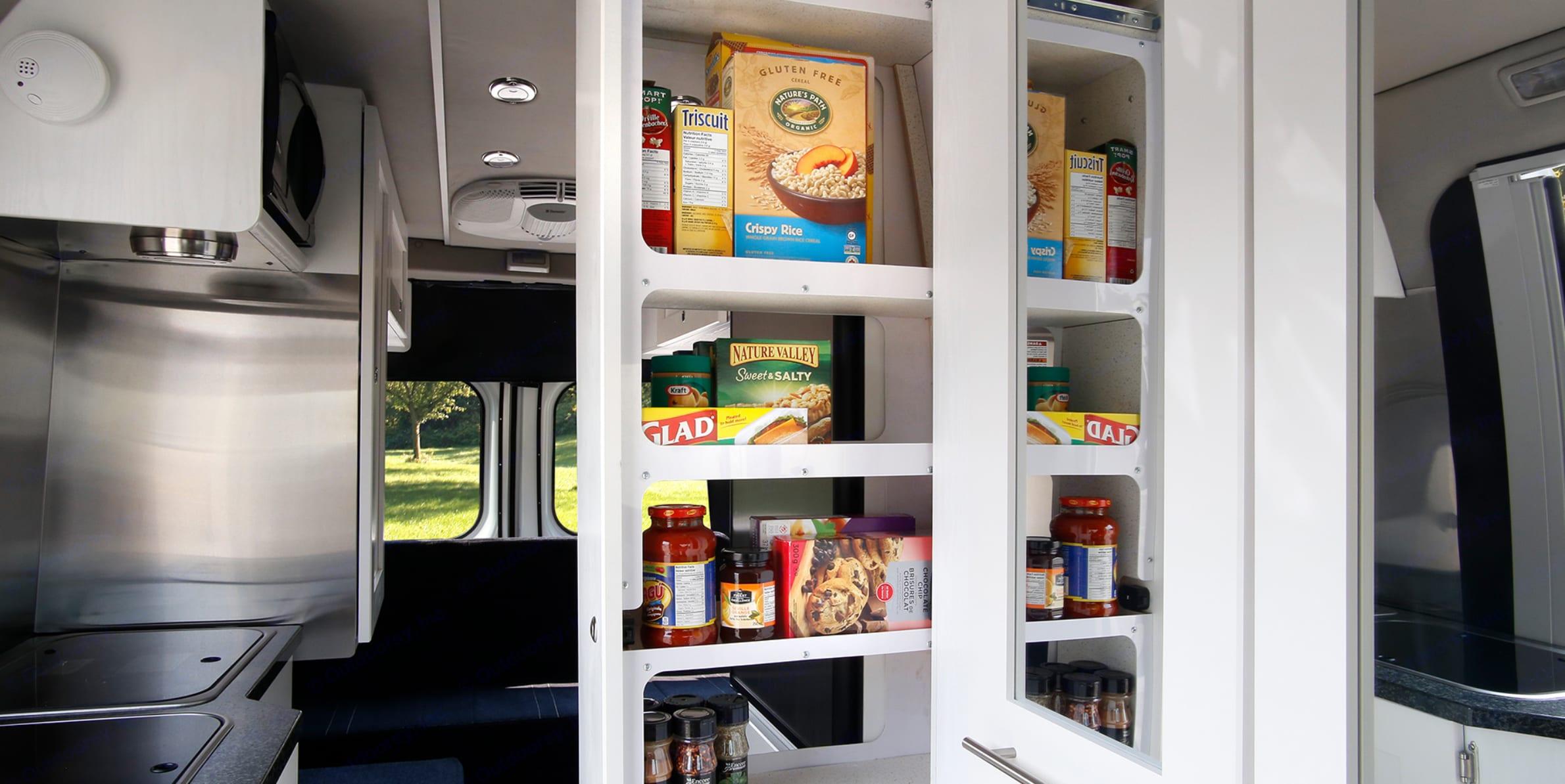 Large slide-out pantry - food not included :) (Source: Roadtrek). Roadtrek Zion SRT 2019