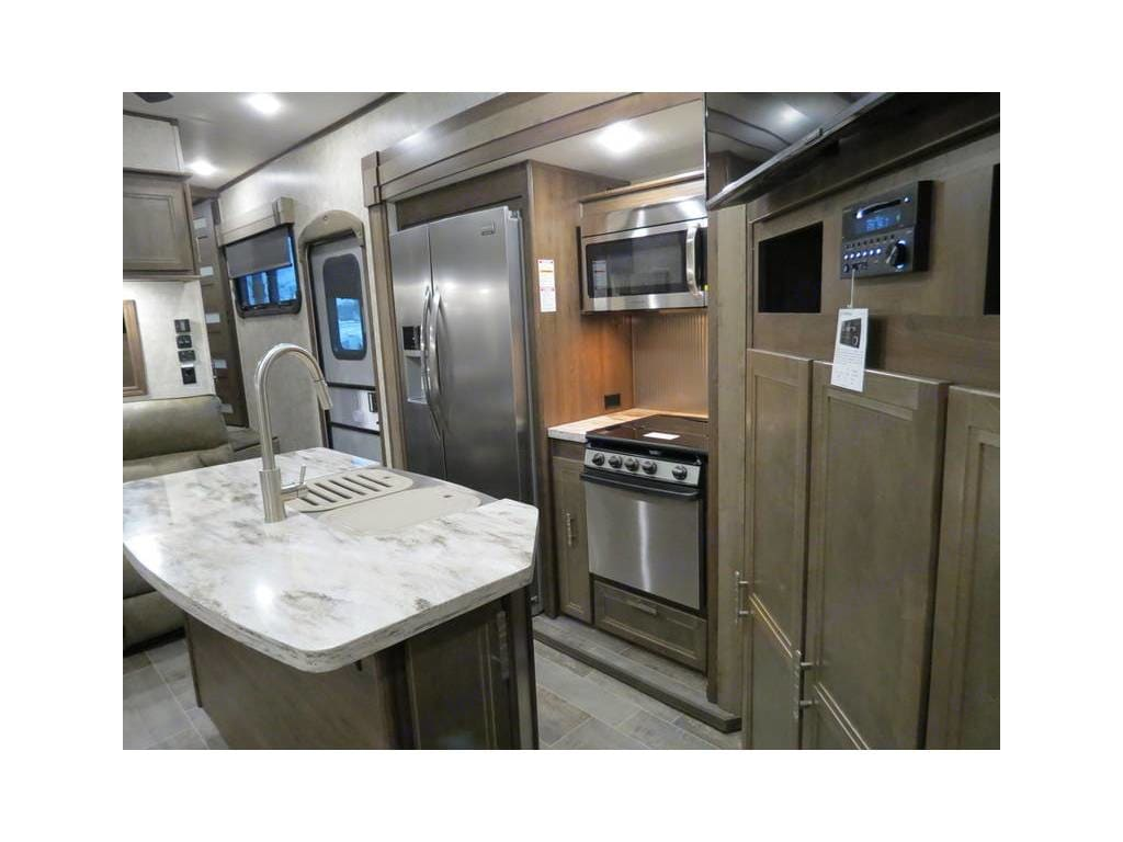 Residential refrigerator, island with double sink, conventional oven, 2 bar stools. Open Range 3x 2019