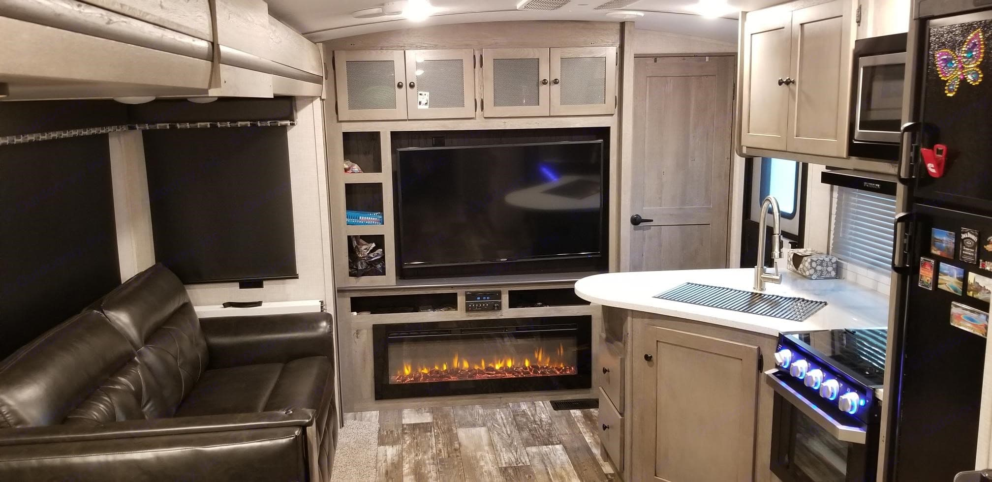 Living and kitchen area are spacious and the 55 inch TV has a wonderful picture.. Keystone Outback 2019