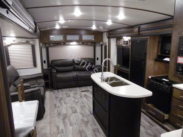 Not a current picture but still looks brand new! . Keystone Cougar Half-Ton 2018