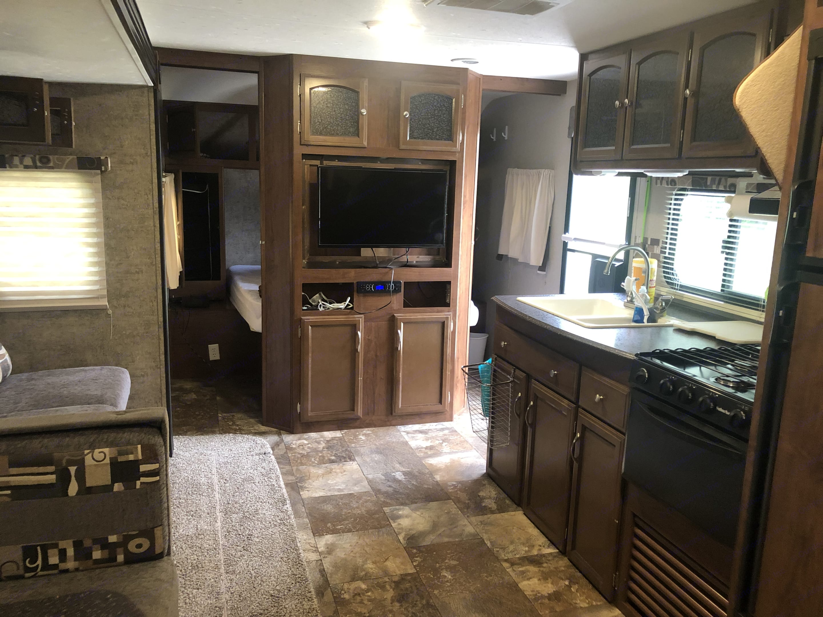 Looking from the bunkroom through the kitchen/living room towards the master bedroom. Coachmen Freedom Express 2017
