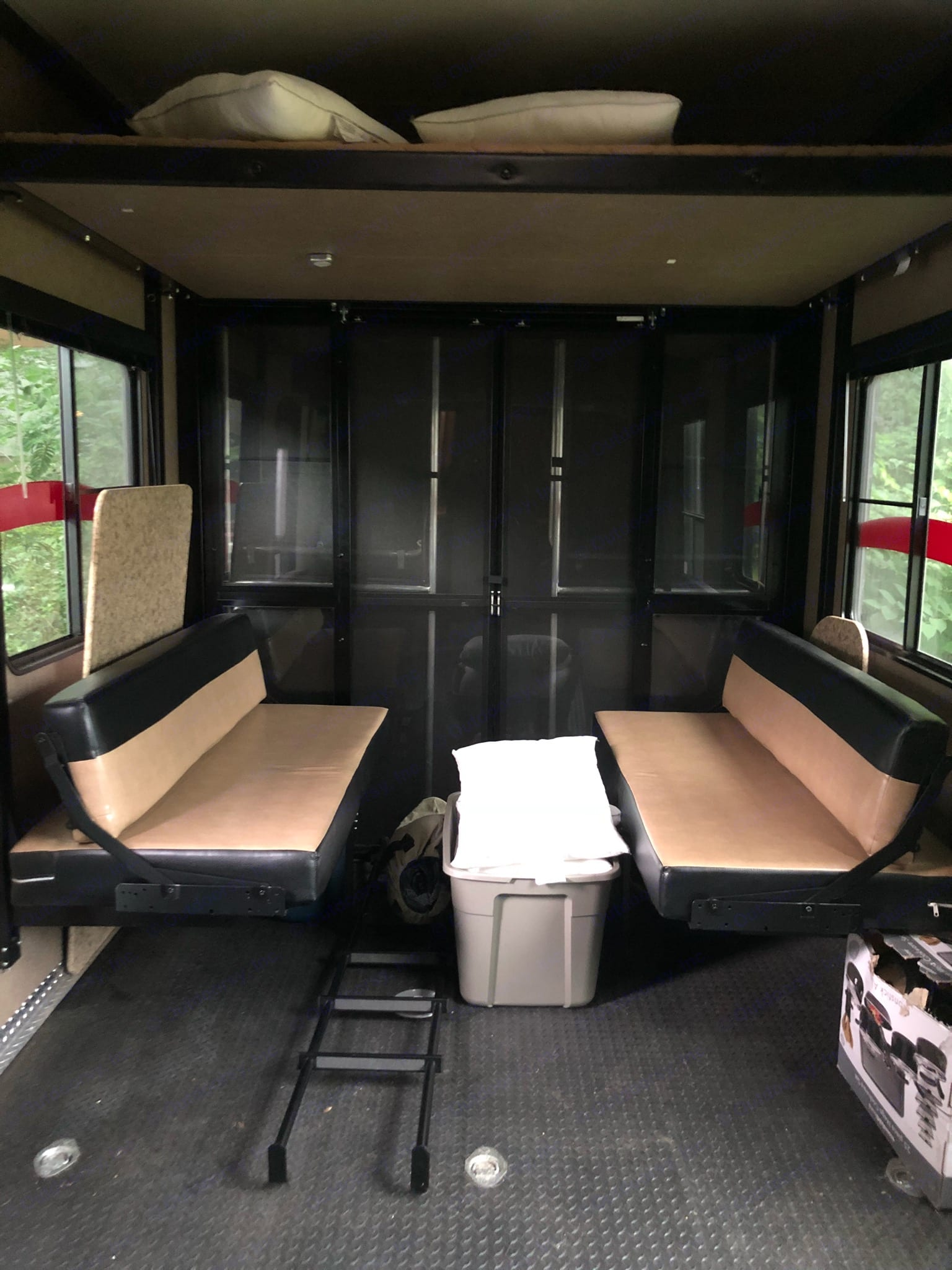 Garage has two queen size beds, with the bottom one being easily turned into a table with benches.. Heartland Road Warrior 2013