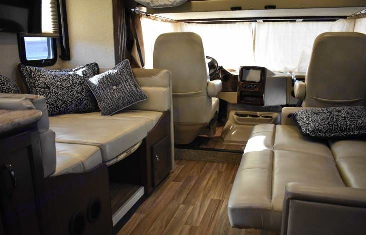 Dinette converts to a bed and the coach also converts to another bed. Thor Motor Coach A.C.E 2019