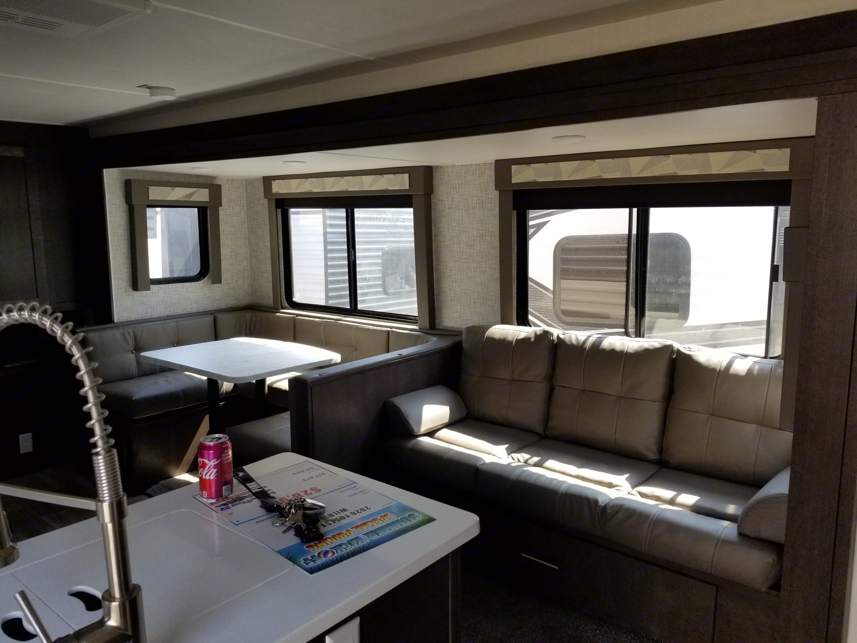 Large sofa and u-shaped dinette, also convert to sleeping accommodations. 2 at the dinette and 2 at the couch, unless you've got small children, you can pack them in.... Forest River Wildwood 2020
