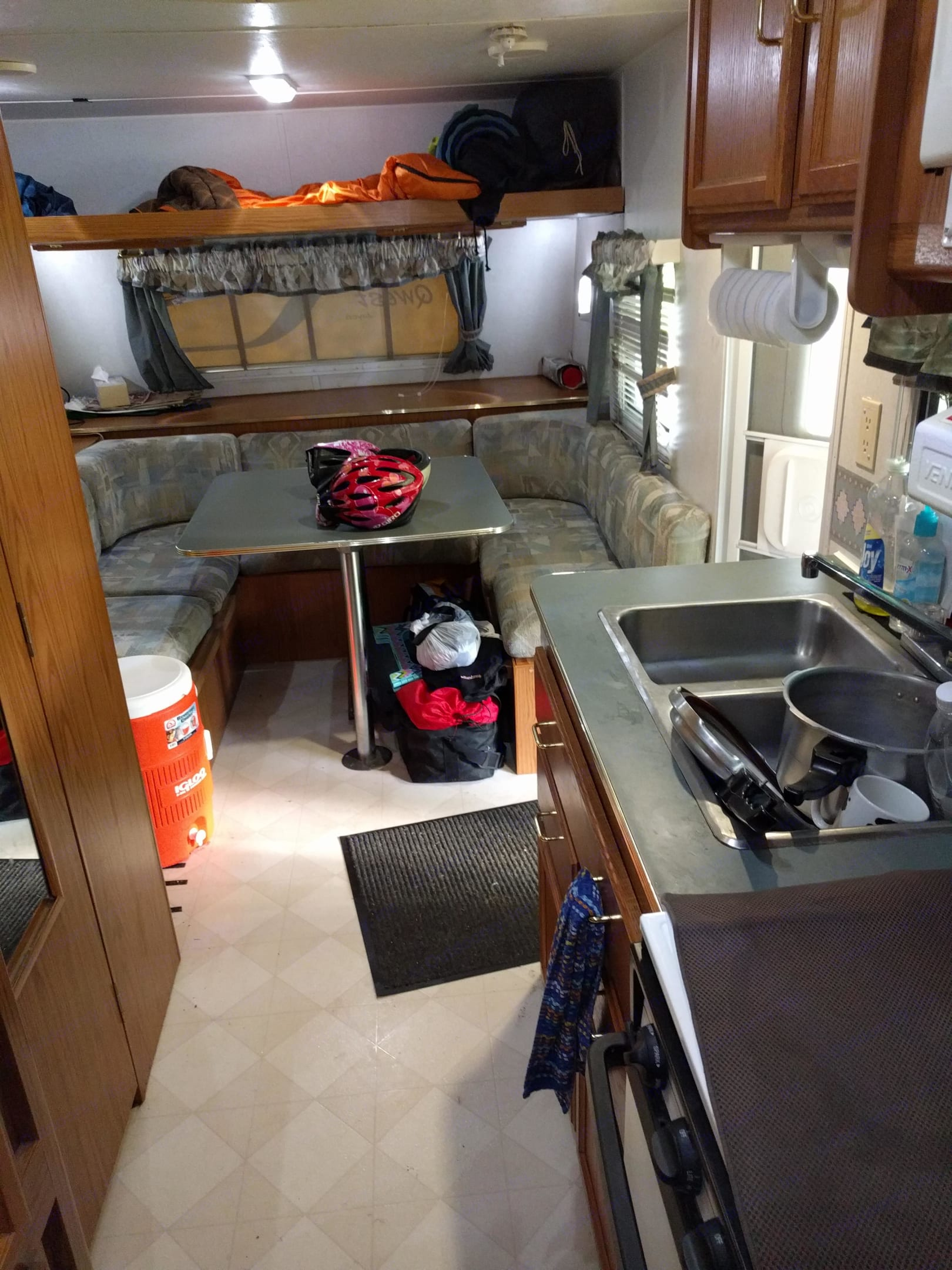 Kitchen and dining table / bed area. Jayco Qwest 2000