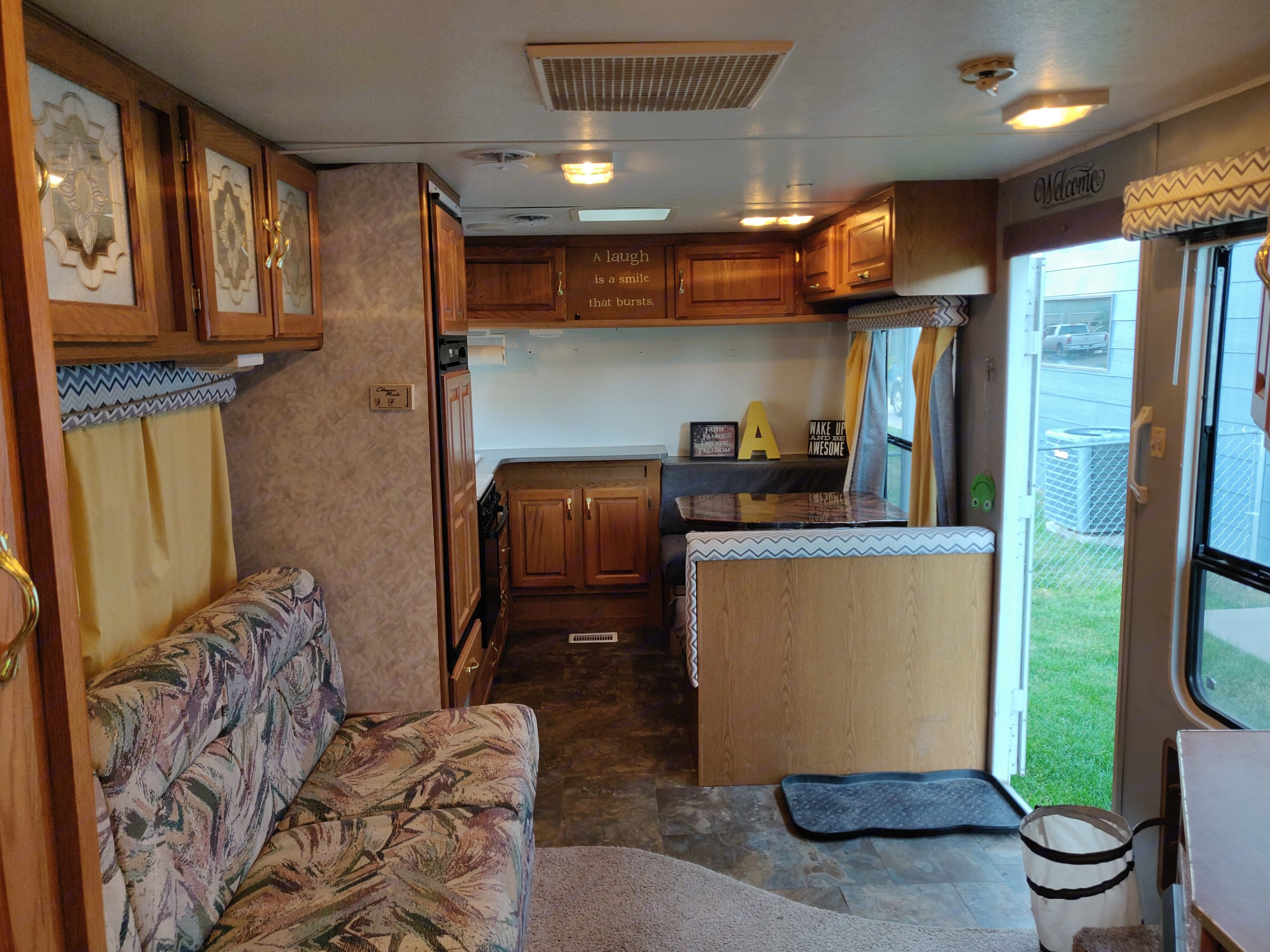 Right side of Camper when entering. Table converts to bed, sink, refrigerator and freezer, stove, oven, and LOTS of storage!. Jayco Eagle M 242 FK 1998