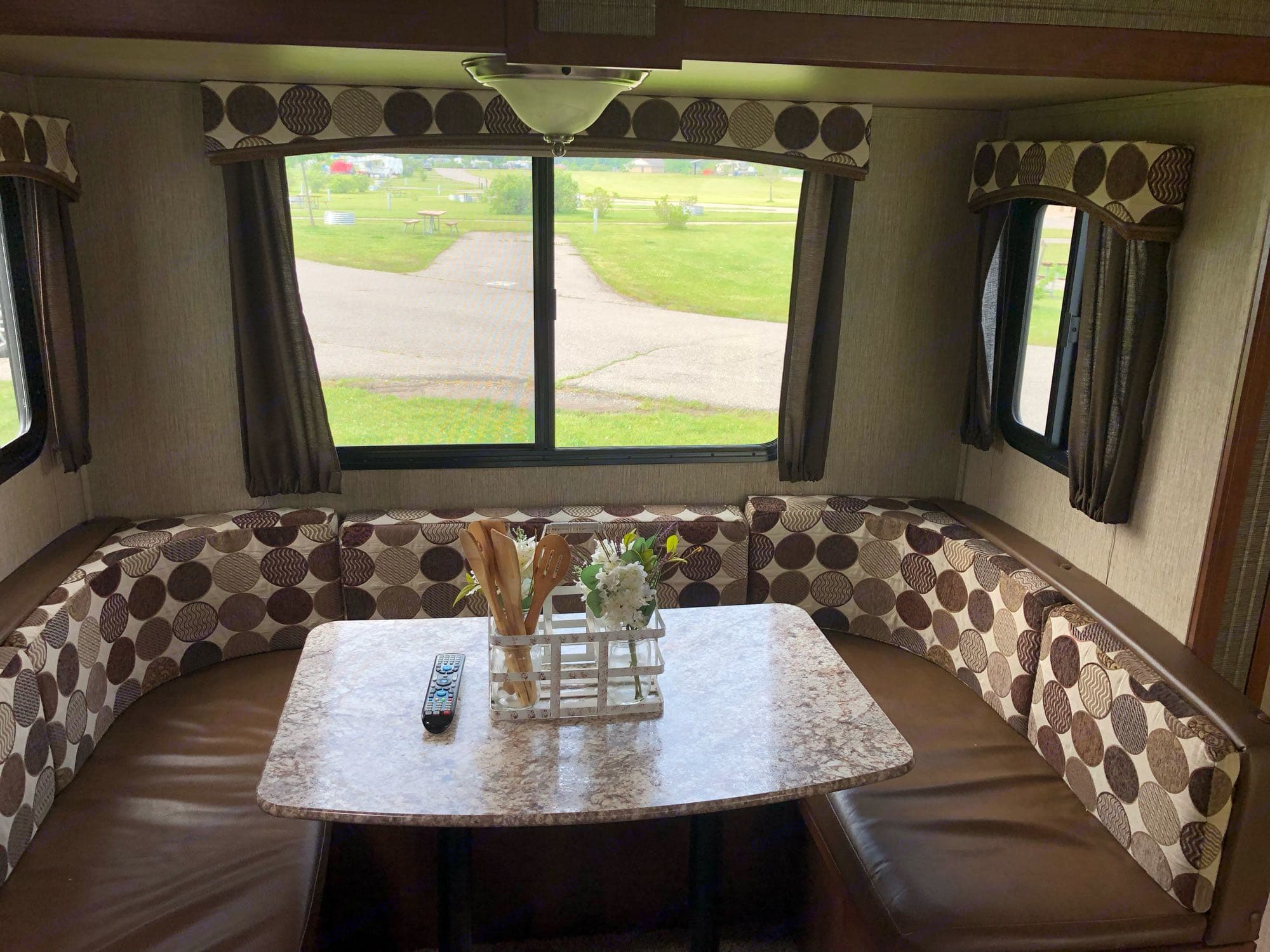 Kitchen table, easily allows up to 4 people to eat at. The table does break down to a bed that could sleep 2 adults.. Keystone Passport 2017