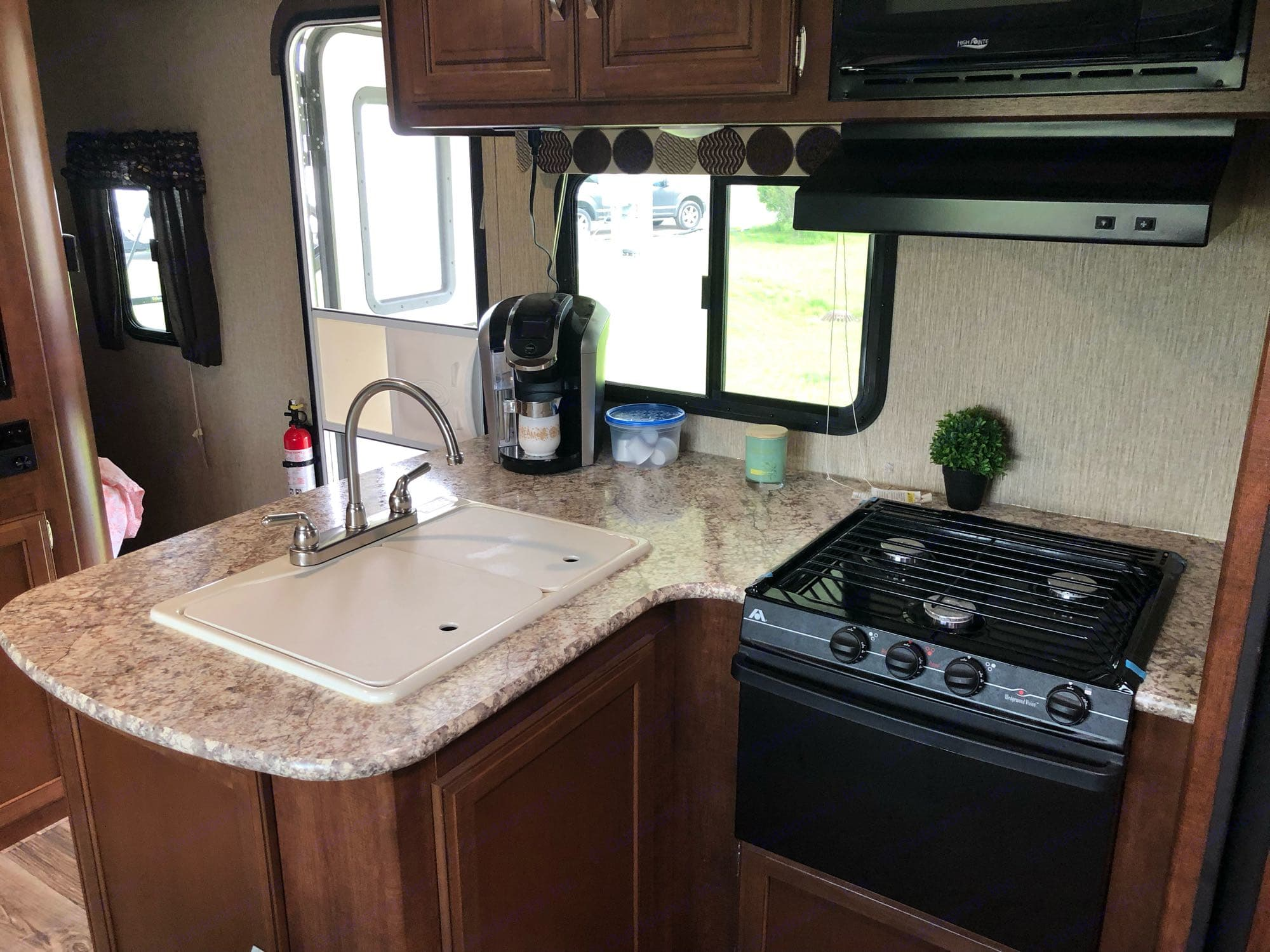 Kitchen area. The Keurig coffee maker is included!  Along with Dishes, cups, and utensils.. Keystone Passport 2017