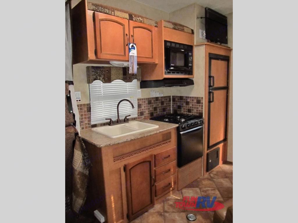 make any meal you want with the full double sink,3 burner stovetop,microwave or oven. Forest River Puma 2012