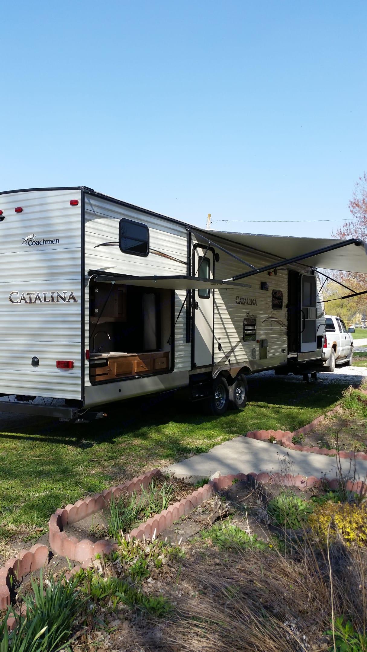 Shows outdoor kitchen . Coachmen Catalina 2016