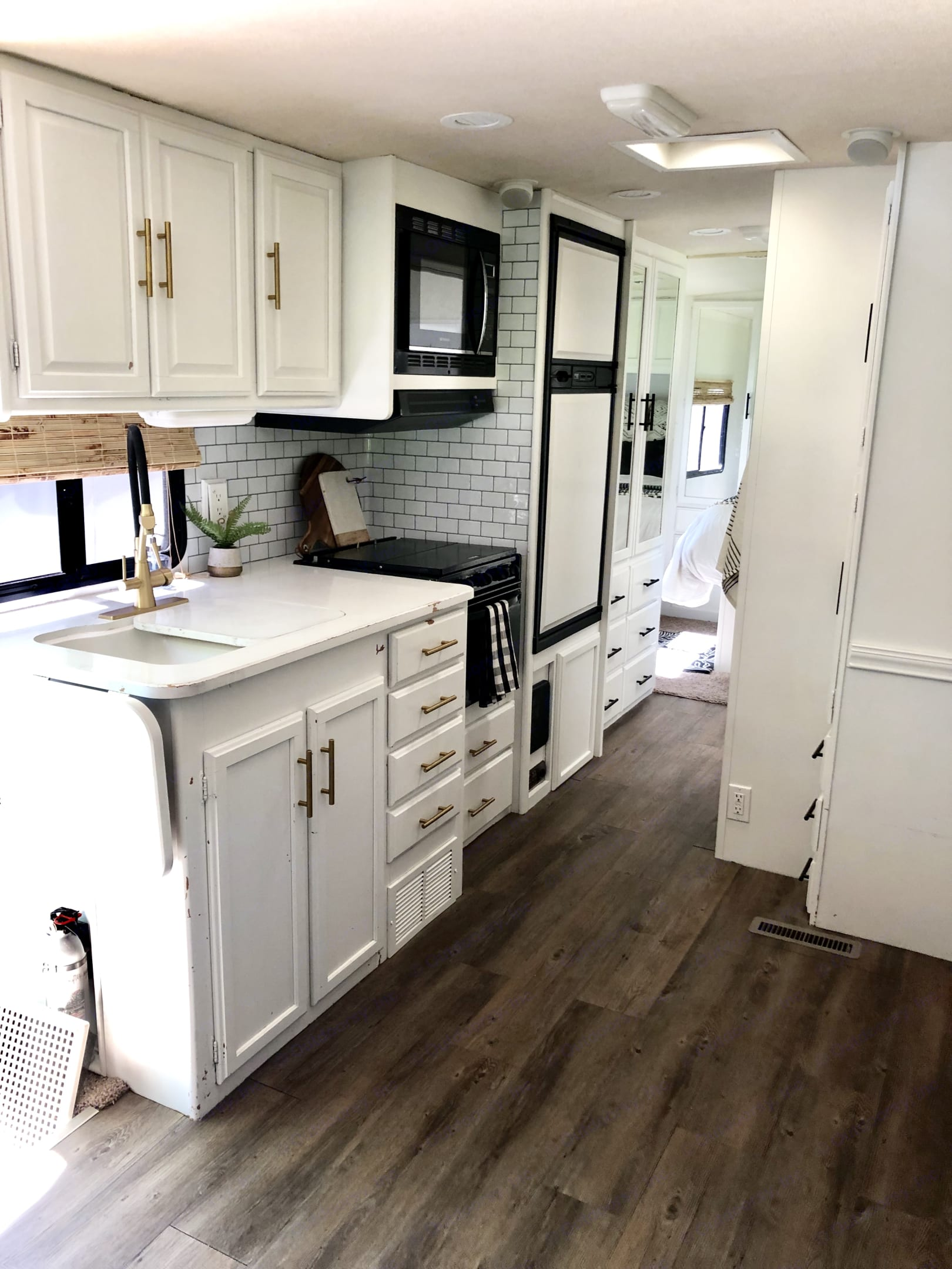 Updated kitchen has large sink, cabinets, basic cooking kitchen utensils and pans, 3 burner gas stove, oven, microwave, fridge, and freezer. . Winnebago Sightseer 2007