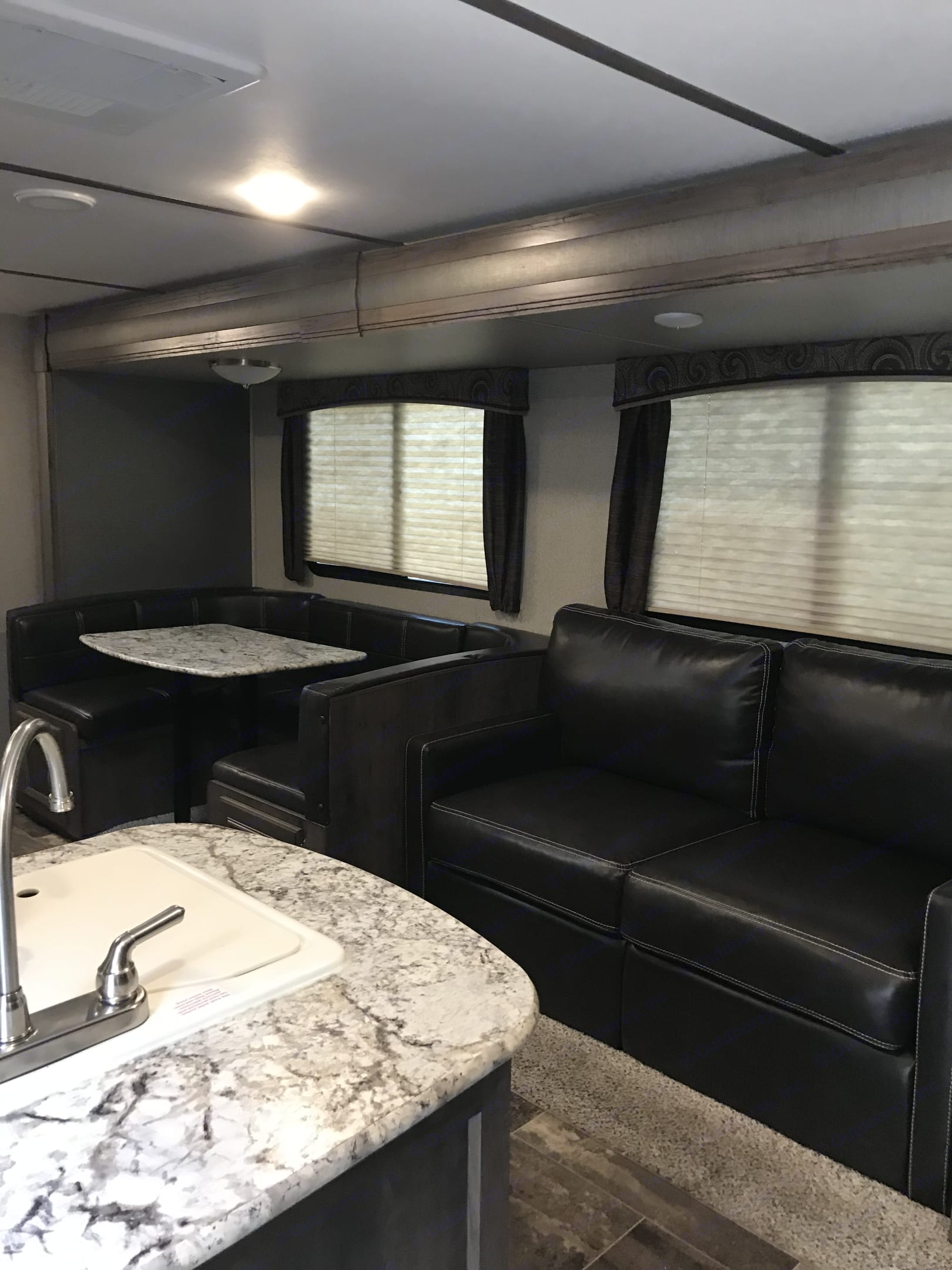 Couch folds out to bed for 2 and table folds down for 2. Keystone Passport 2019
