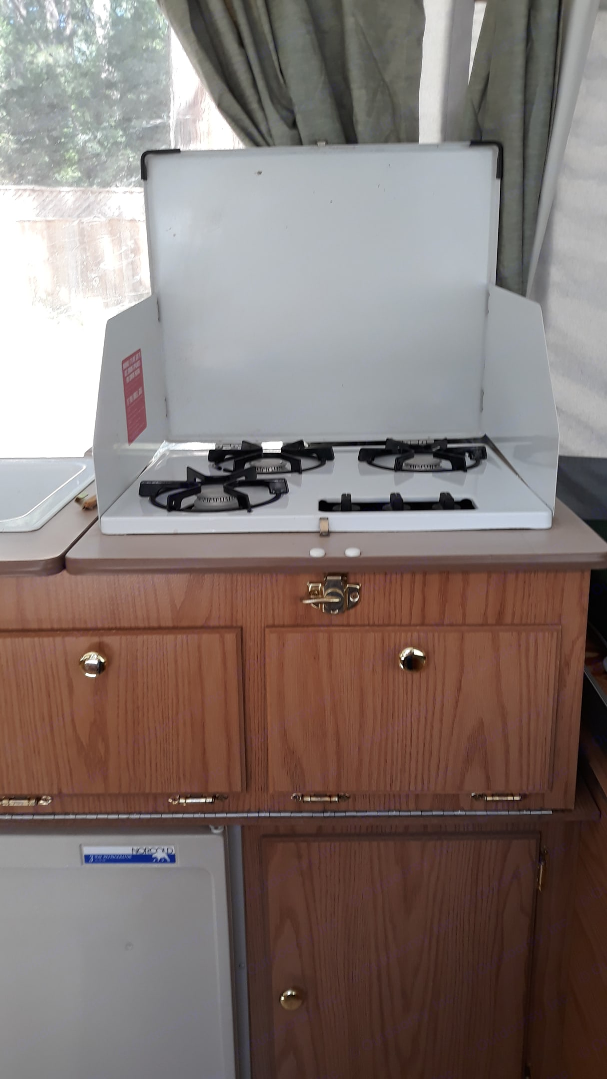 The three burner propane stove. . Coleman Fairview 2000
