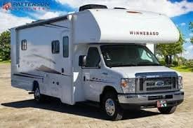 Exterior has awning with LED lights. Winnebago Outlook 2019