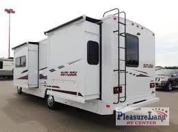 Rear View with slide outs. Winnebago Outlook 2019