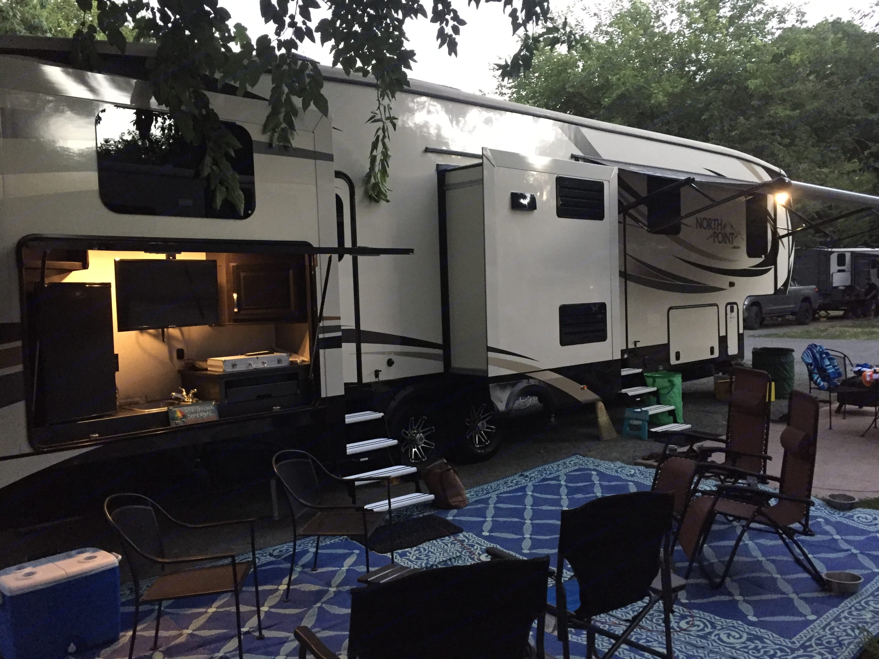 2 entrances and exterior kitchen with TV.  You can enter through back bathroom which leads to the bunk house and also through the main living space into the kitchen/living area.  Queen size bedroom is in the front of the 5th wheel.. Jayco North Point 2017