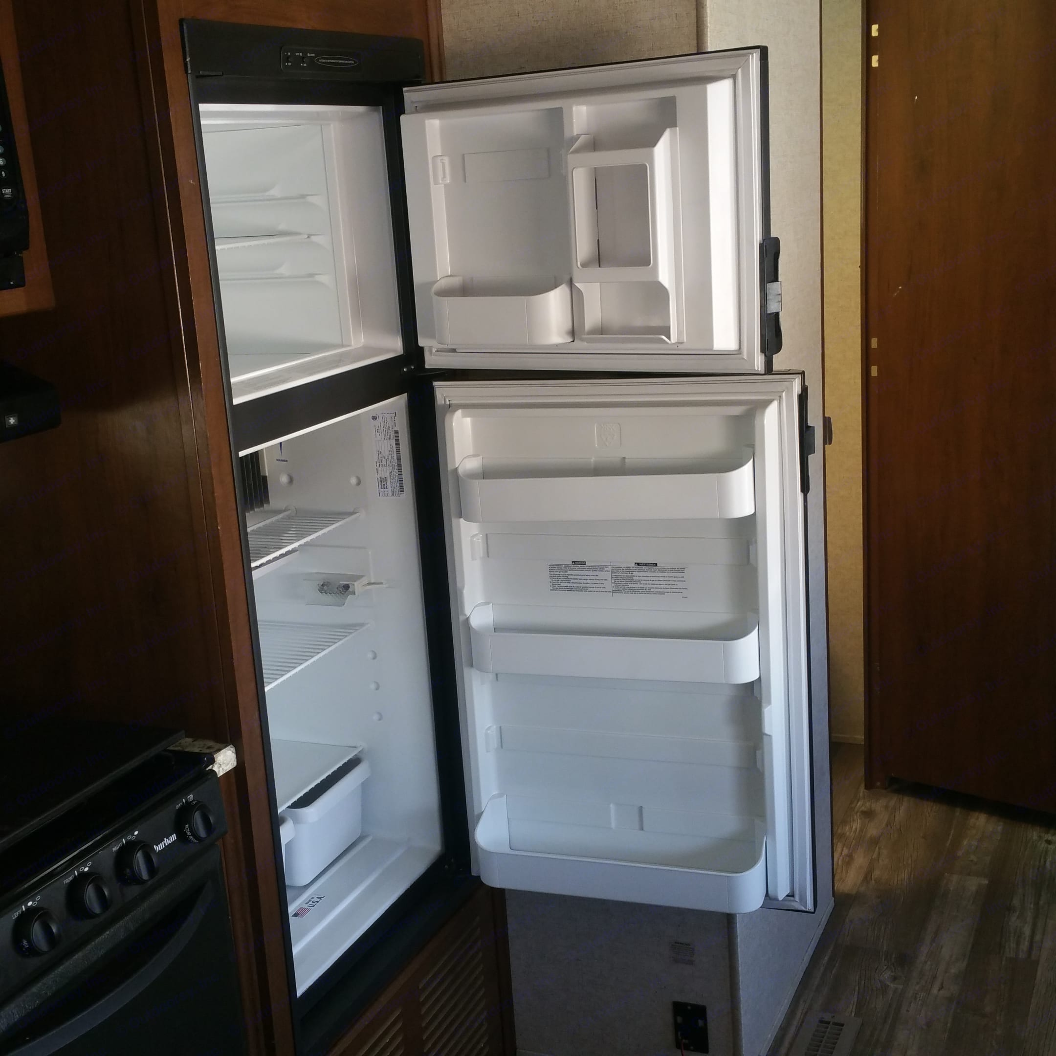 Opened refrigerator, ready for your food and drinks. Heartland Trail Runner 2016