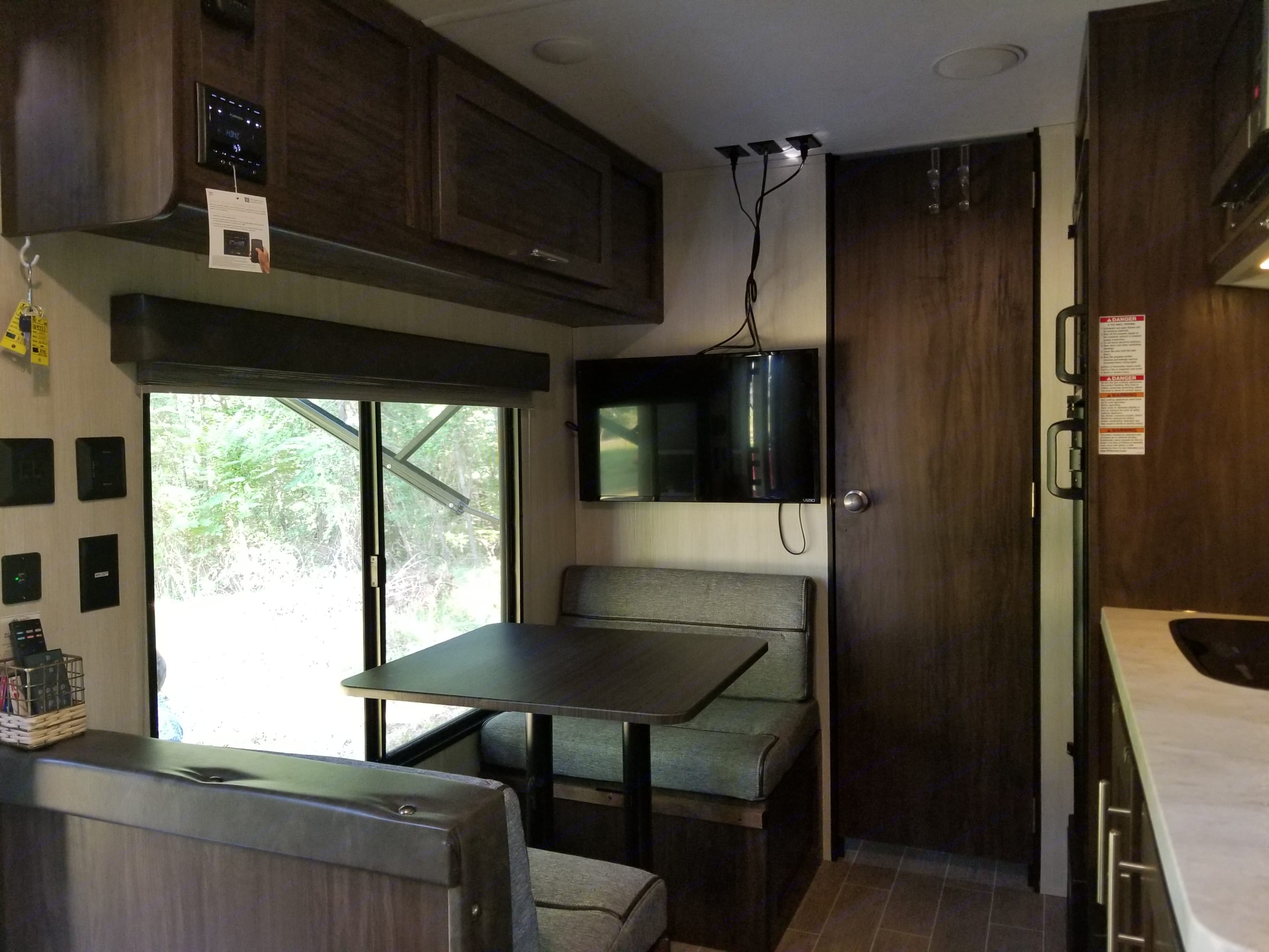 Dinette converts to 6 foot twin bed! 32inch internet cable ready TV, that can be moved outside to view.. Forest River Wolf Pup 2020