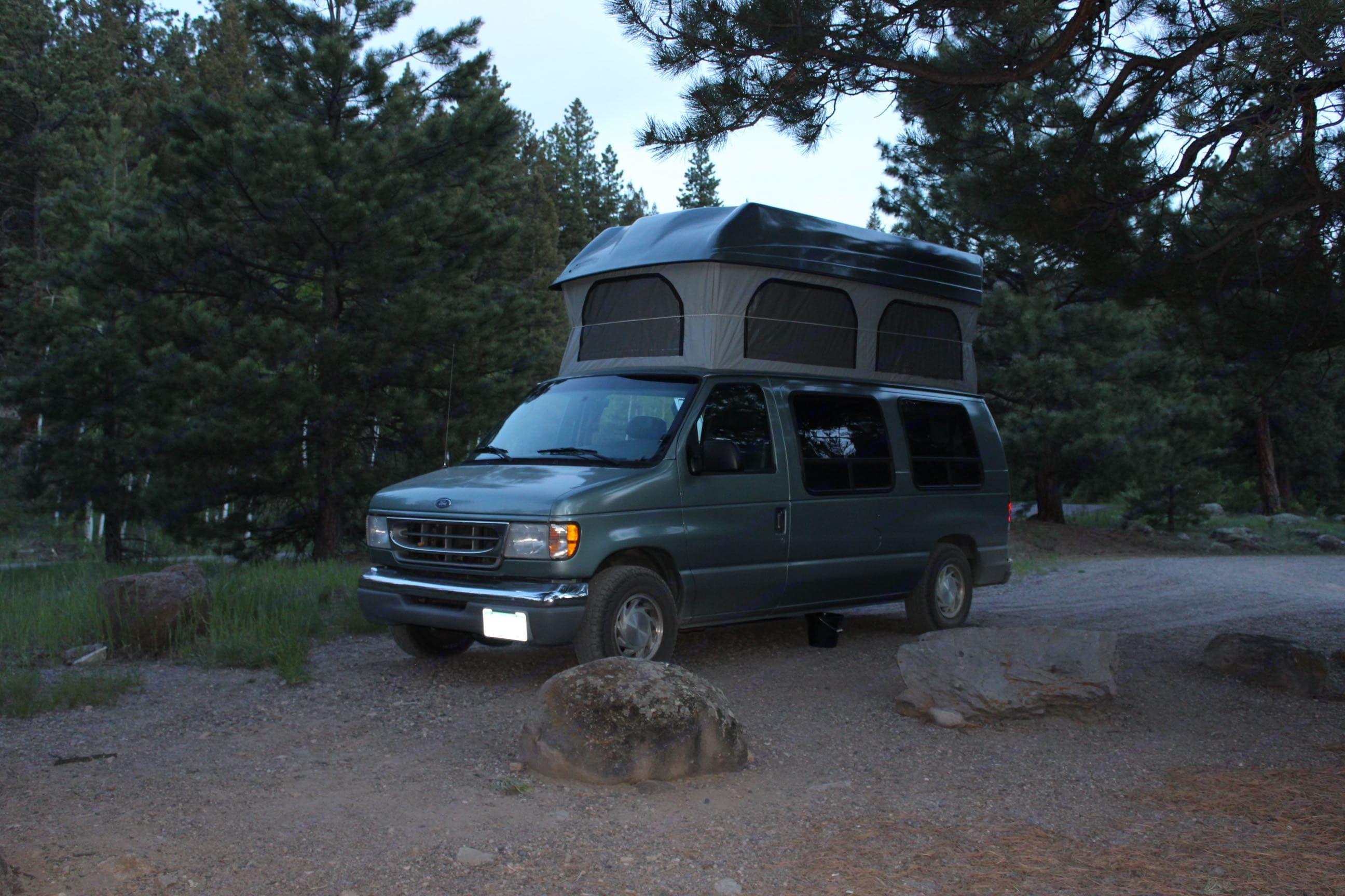Pop top bed is 50 x 80 with 40 inches from bed to ceiling. Ford E 150 Reg Body 2000