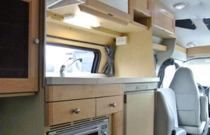 Kitchen included!  A nice place to make breakfast, lunch, or dinner.. Roadtrek 210 Versatile 2005